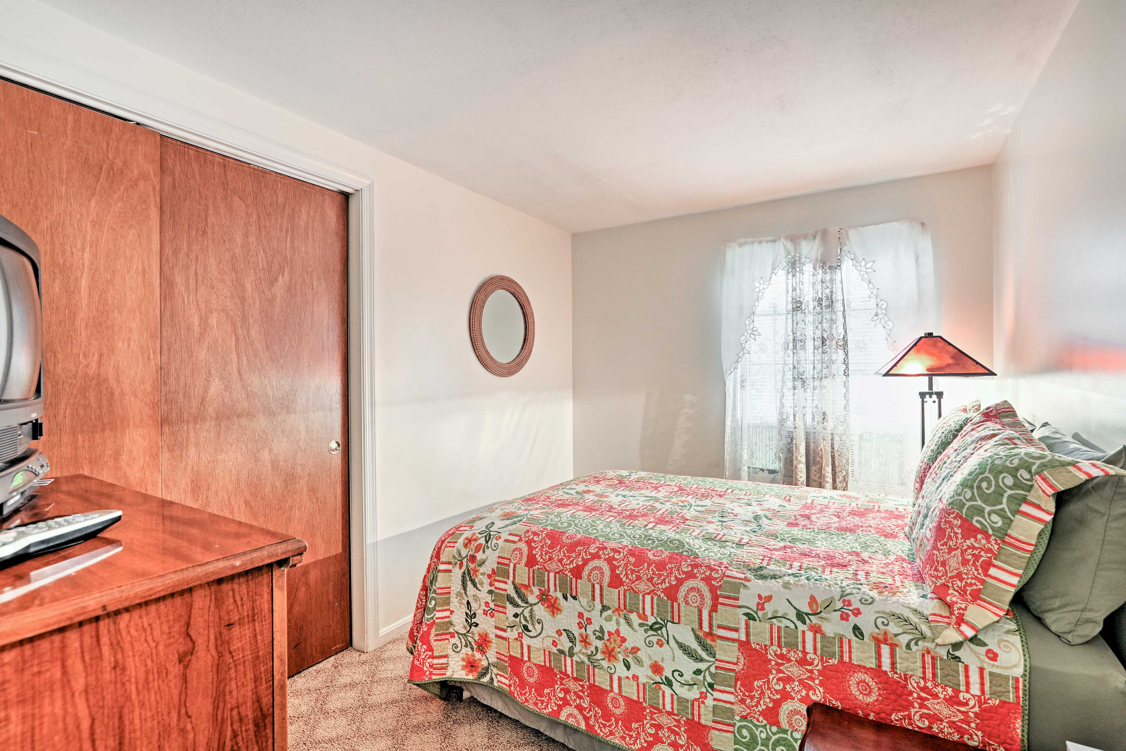 Lie back and watch a movie from the full-sized bed in the second bedroom.