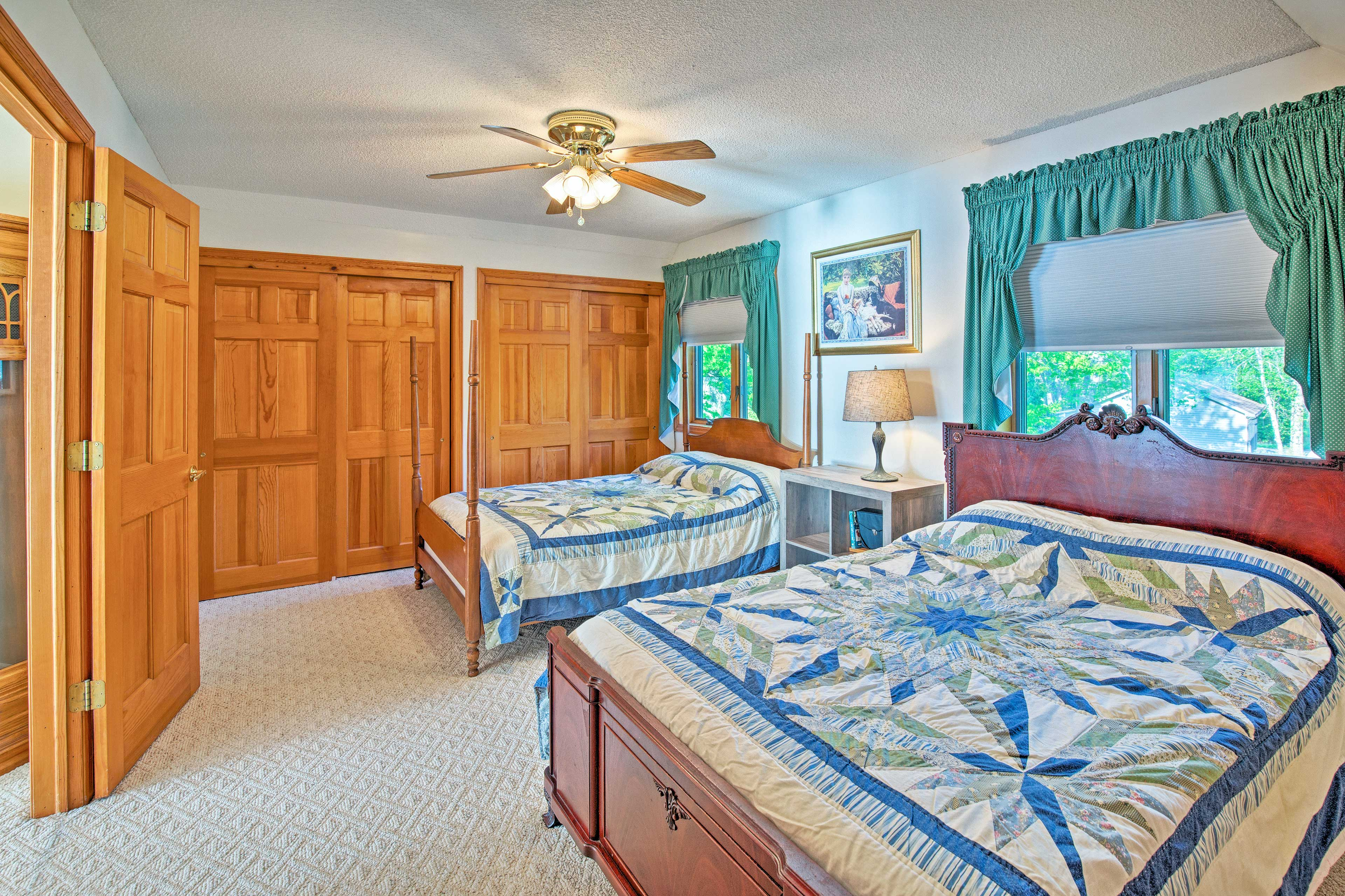 This spacious room boasts 2 full-sized beds.