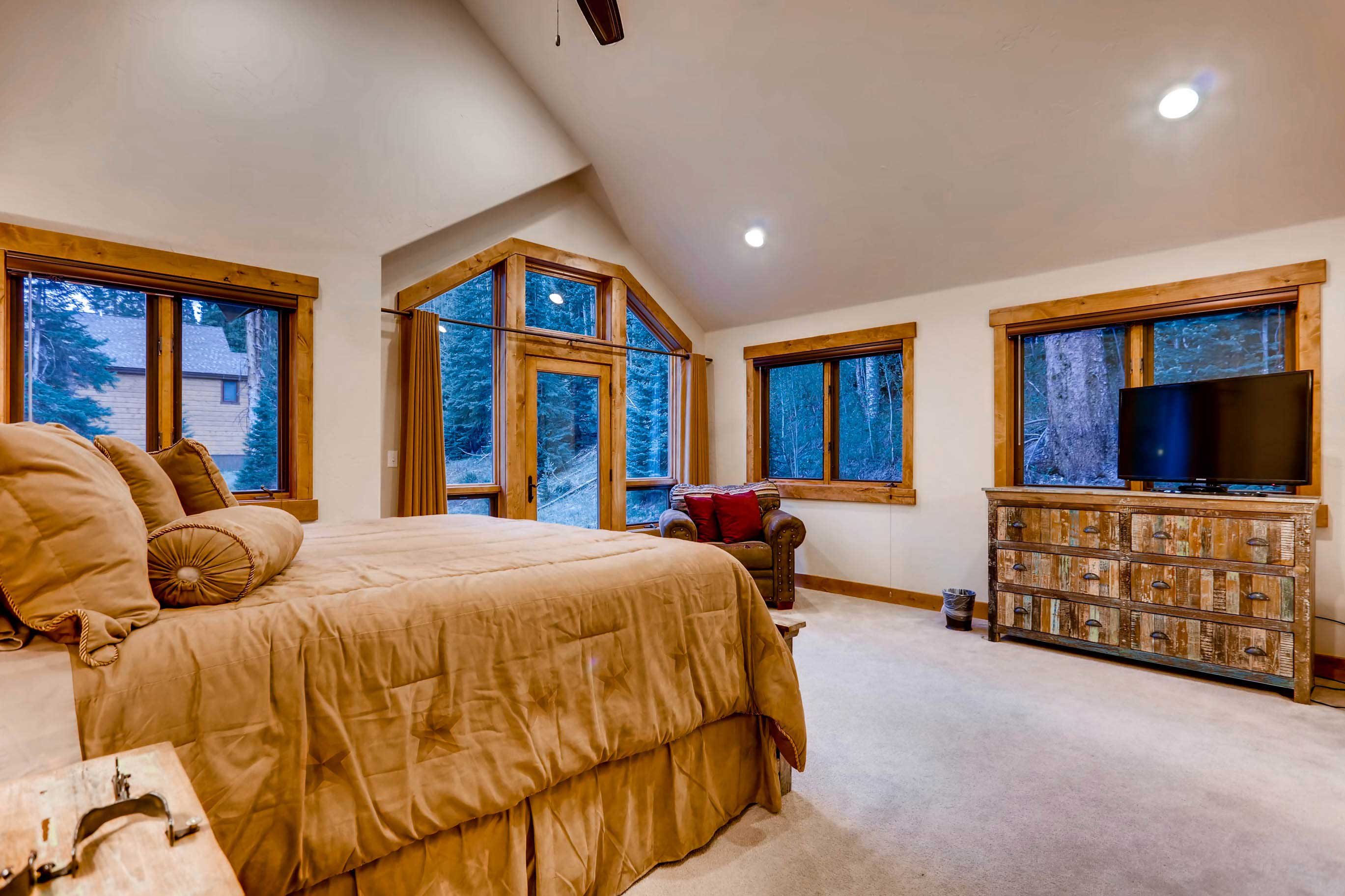 This spacious master bedroom offers a luxurious king bed.