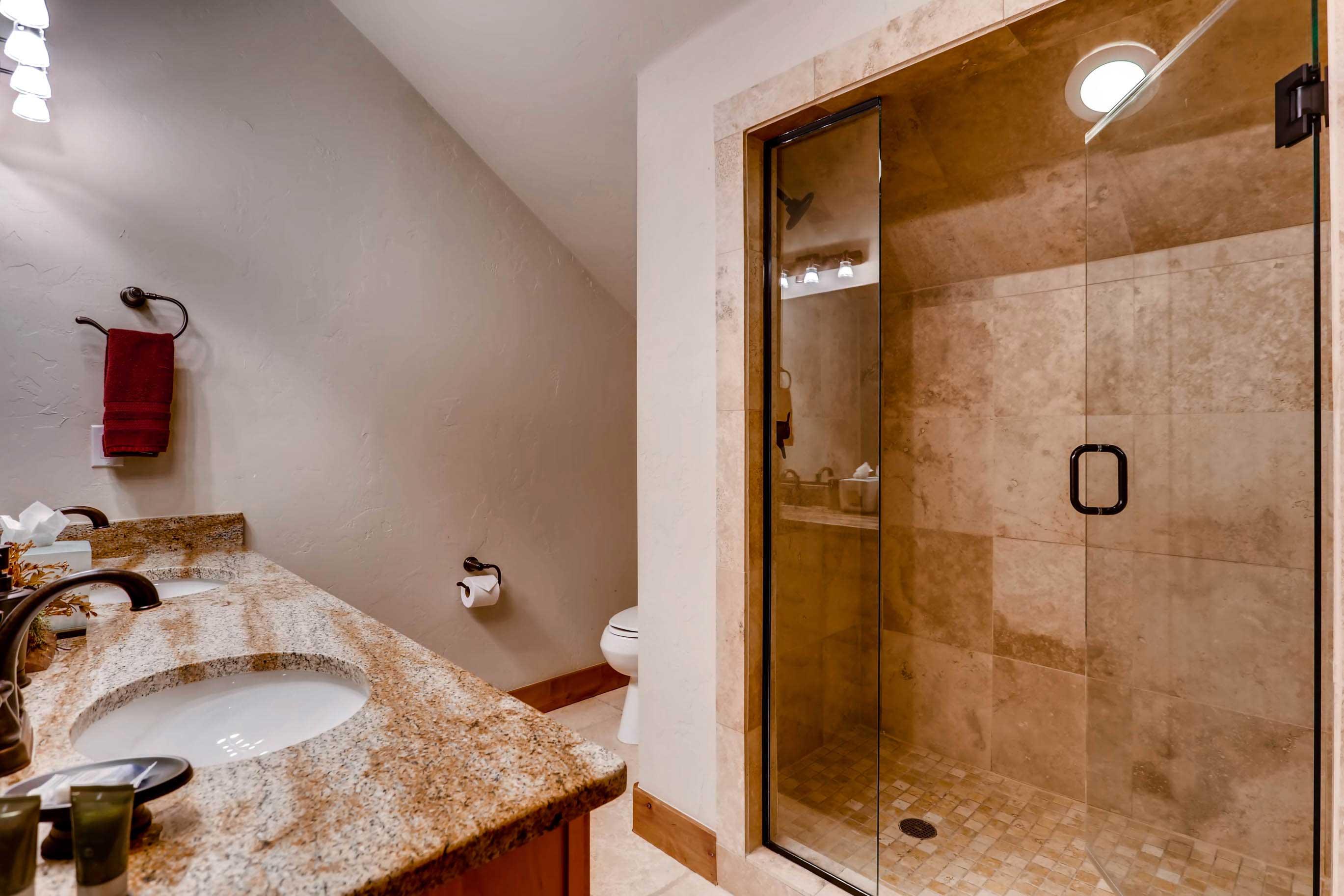 The second floor bathroom has a walk-in shower.