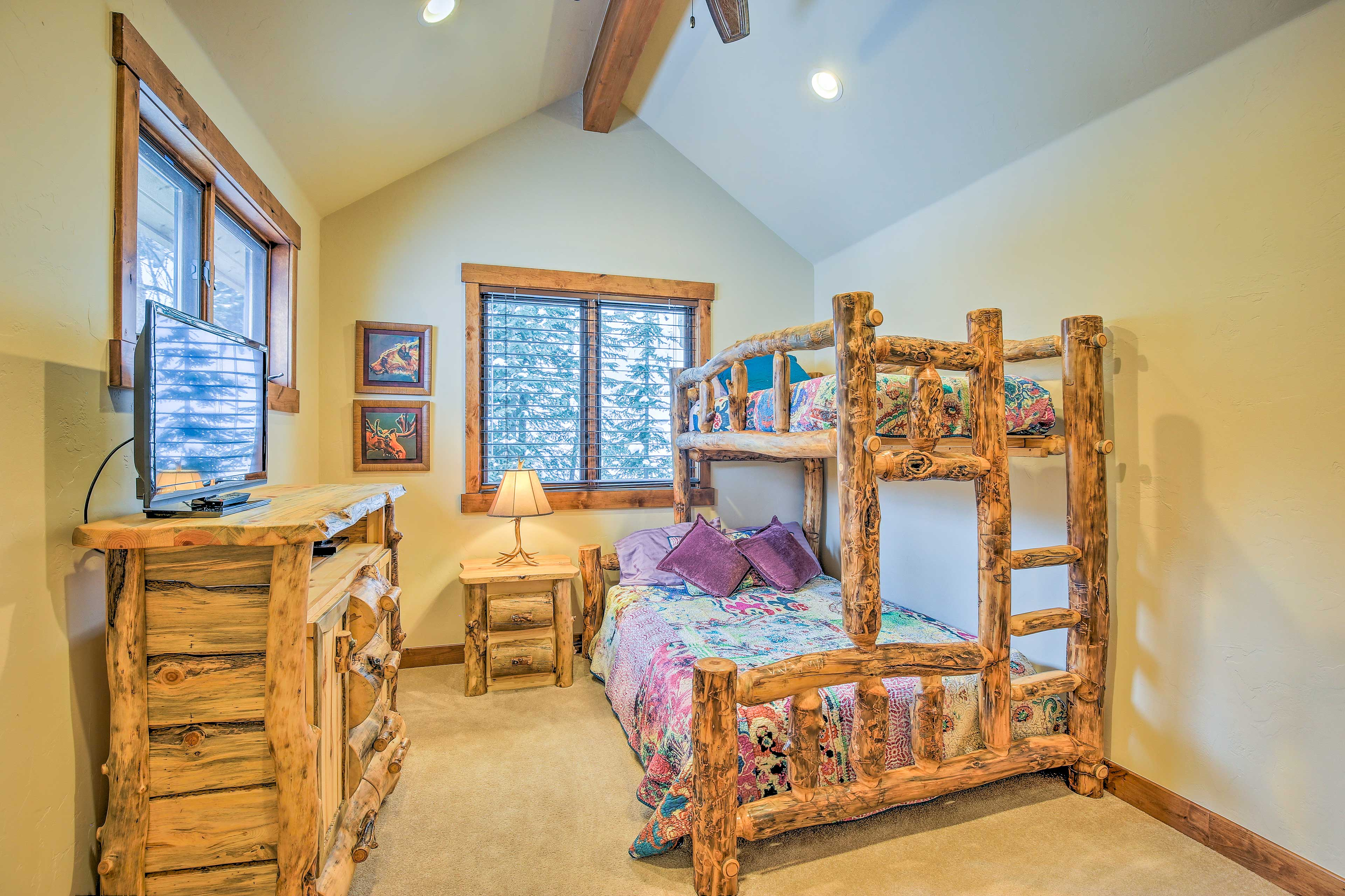 A second twin-over-queen bunk bed completes the last bedroom.