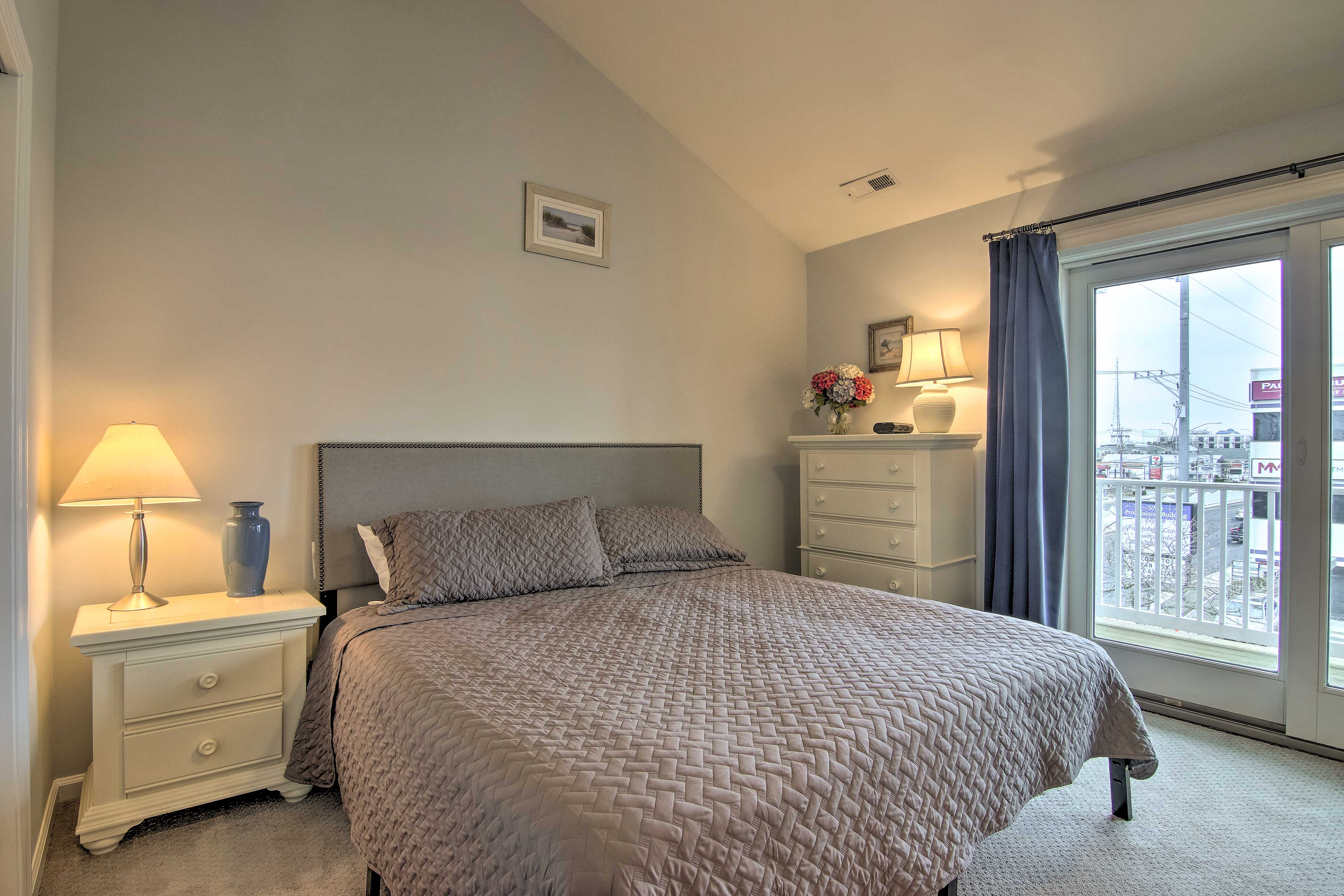 The first master bedroom offers a plush king bed.