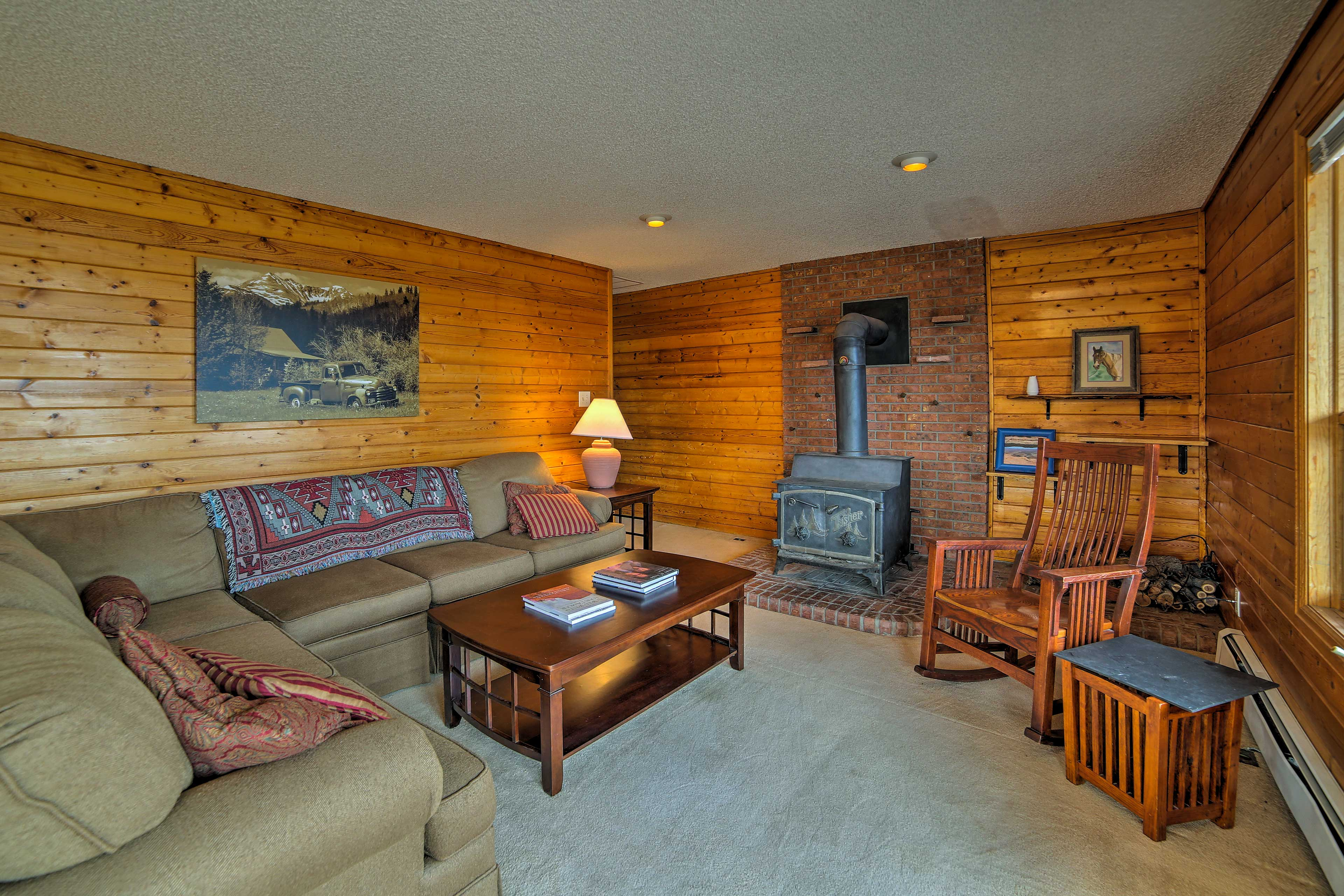Keep warm by the wood-burning stove while admiring the home's rustic charm.