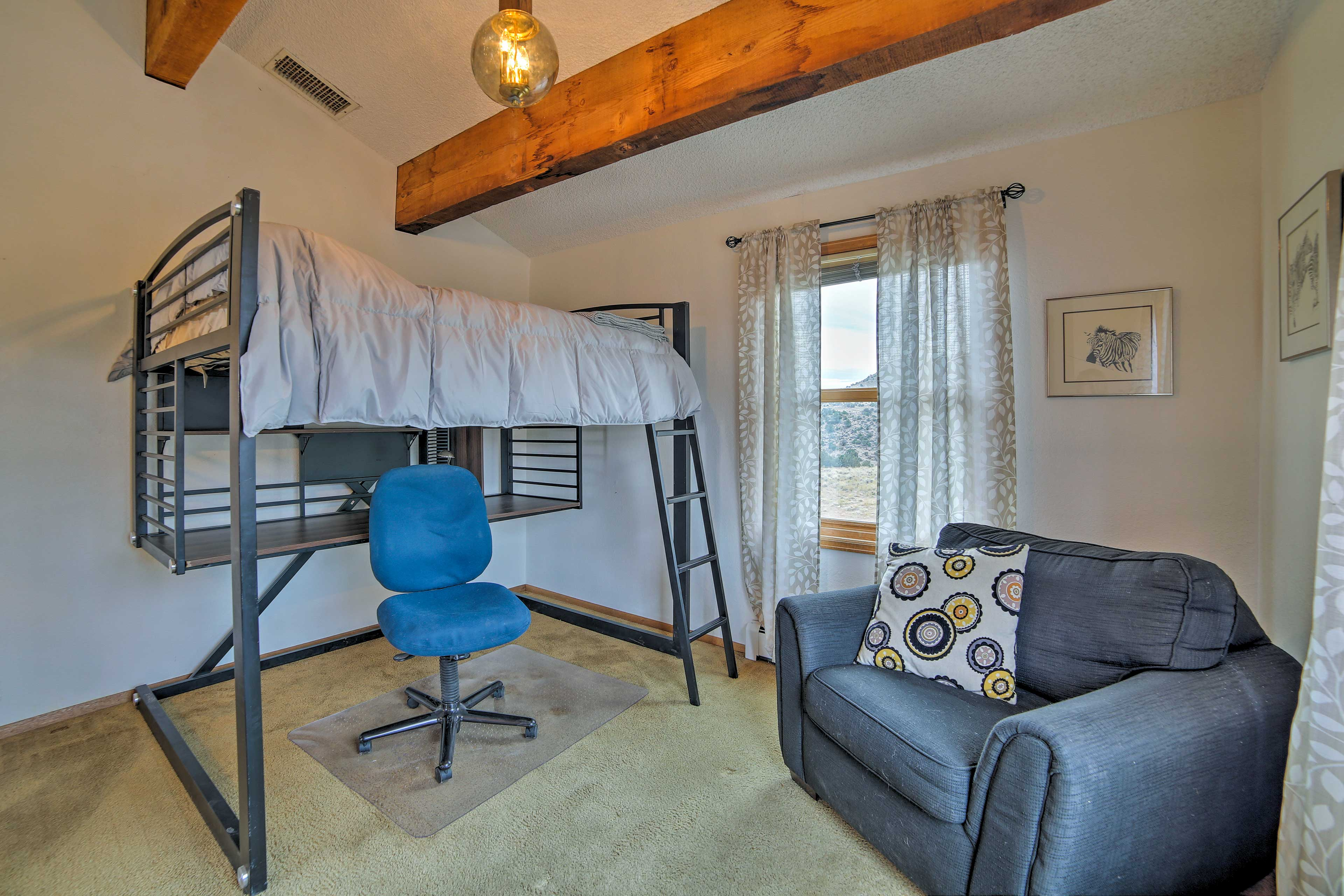 Climb onto the lofted full bed for a peaceful night of rest.