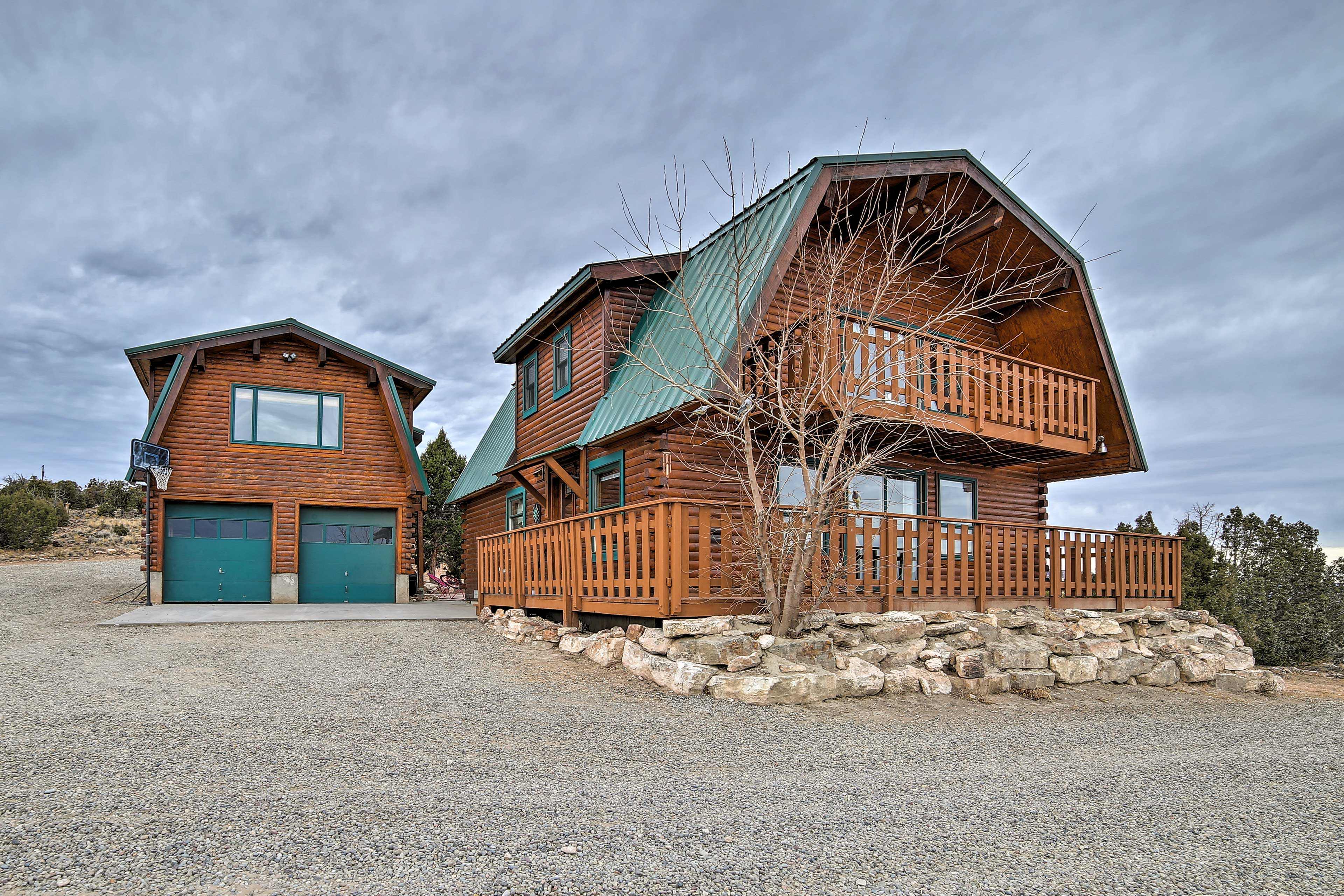 This 2-story Grand Junction log home features a main house and a guest house.