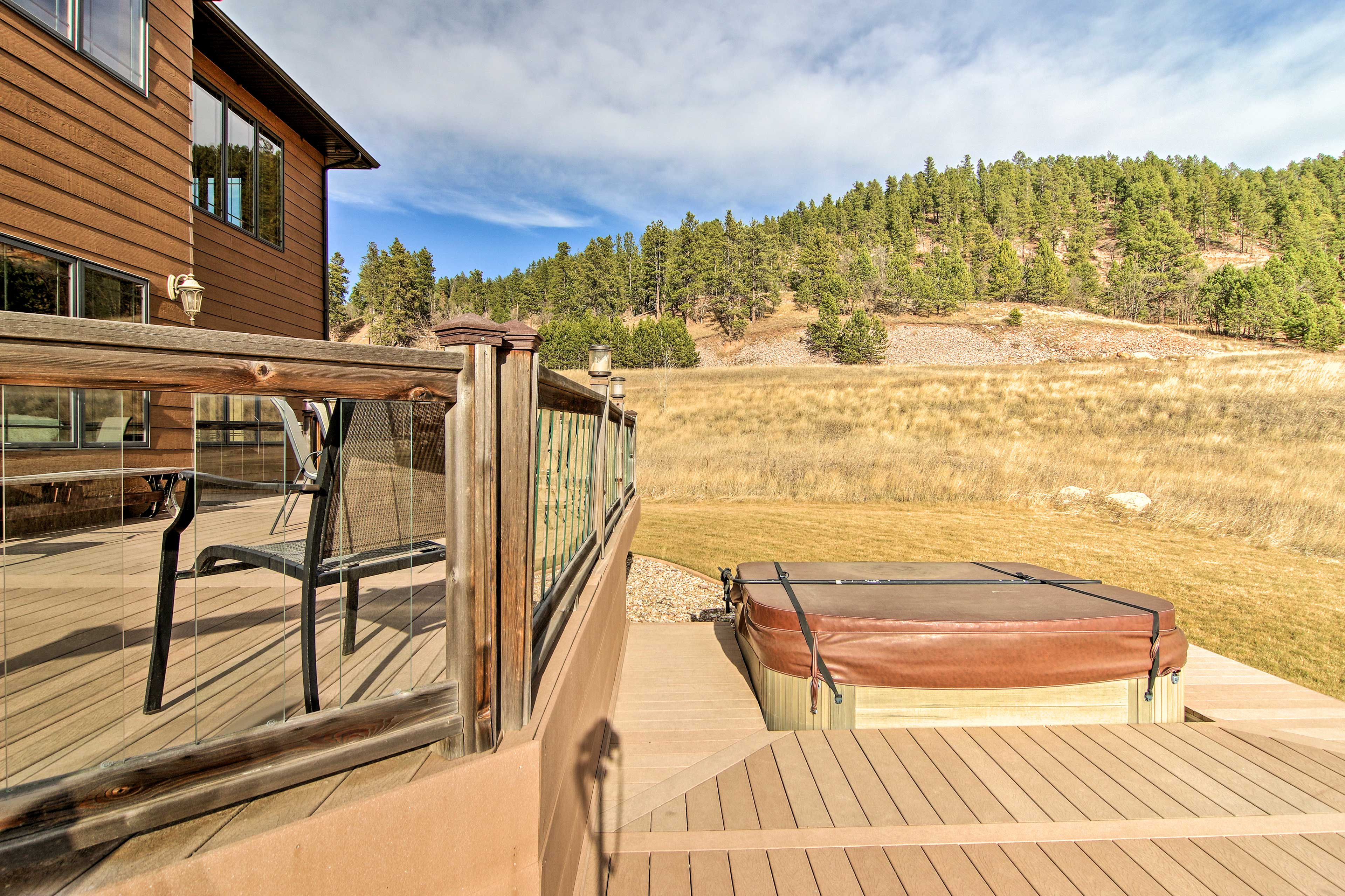 Take in the mountain views while soaking in your private hot tub.