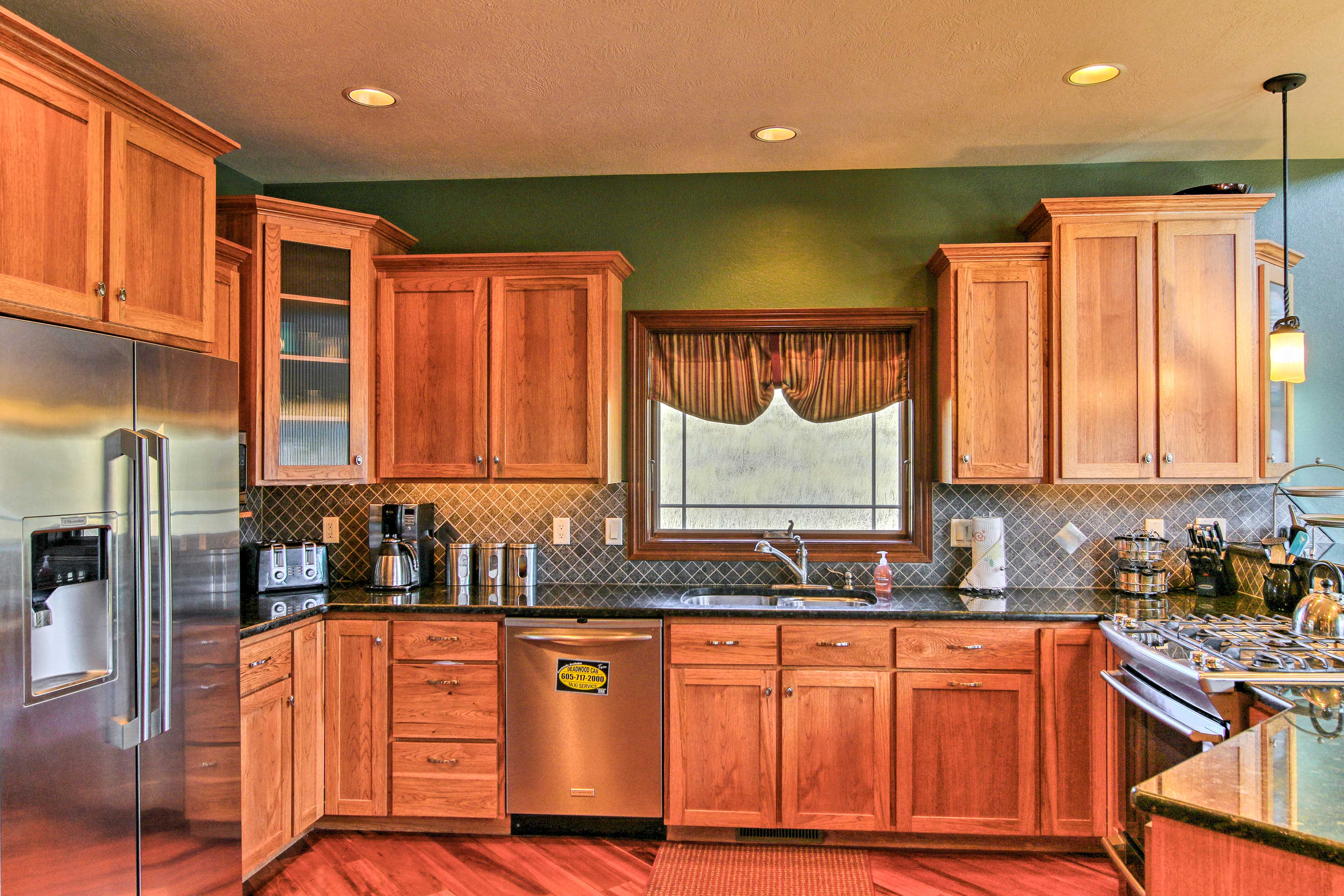 Ample counter space and new stainless steel appliances make home-cooking easy.