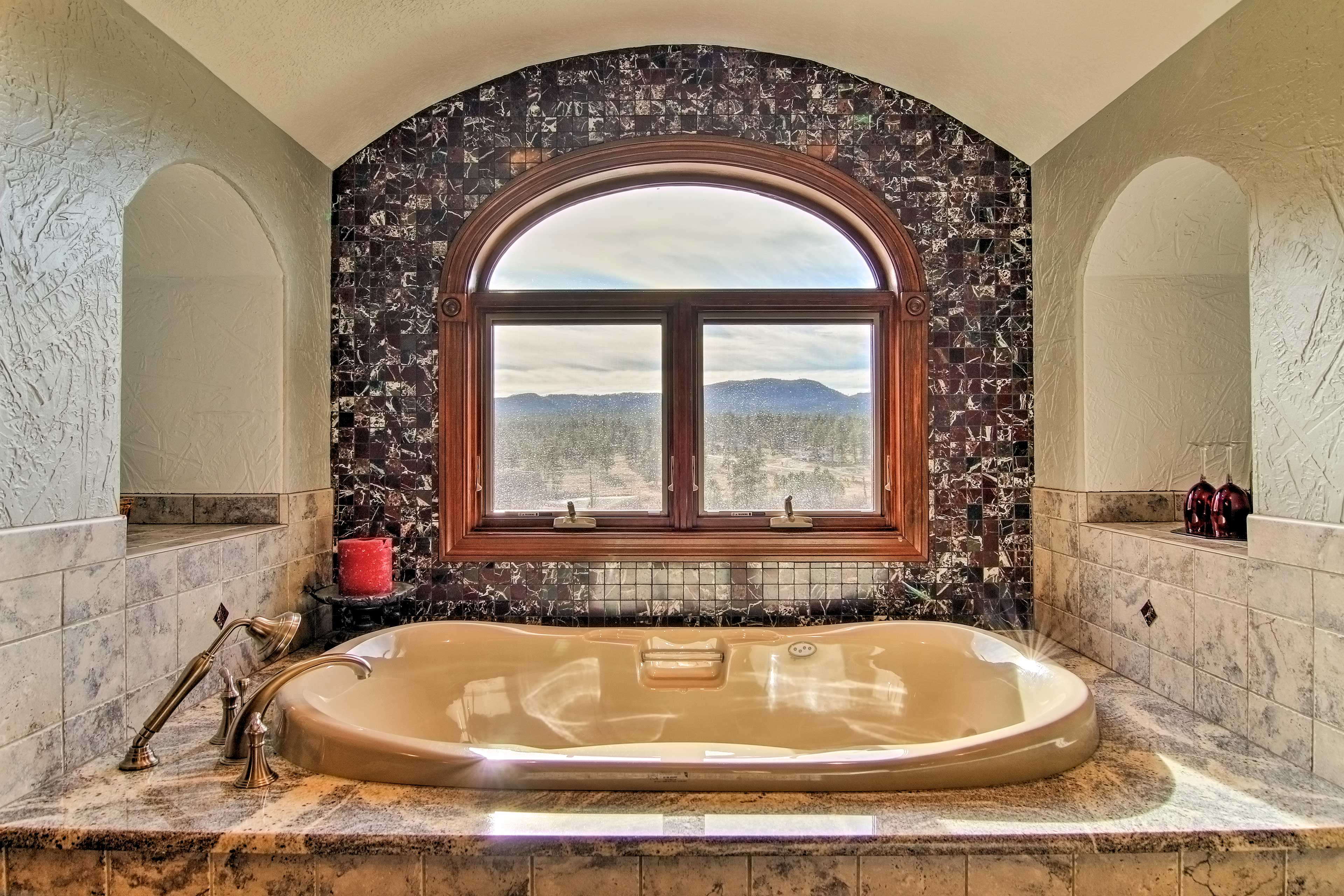 Soak in the tub and enjoy  the views.