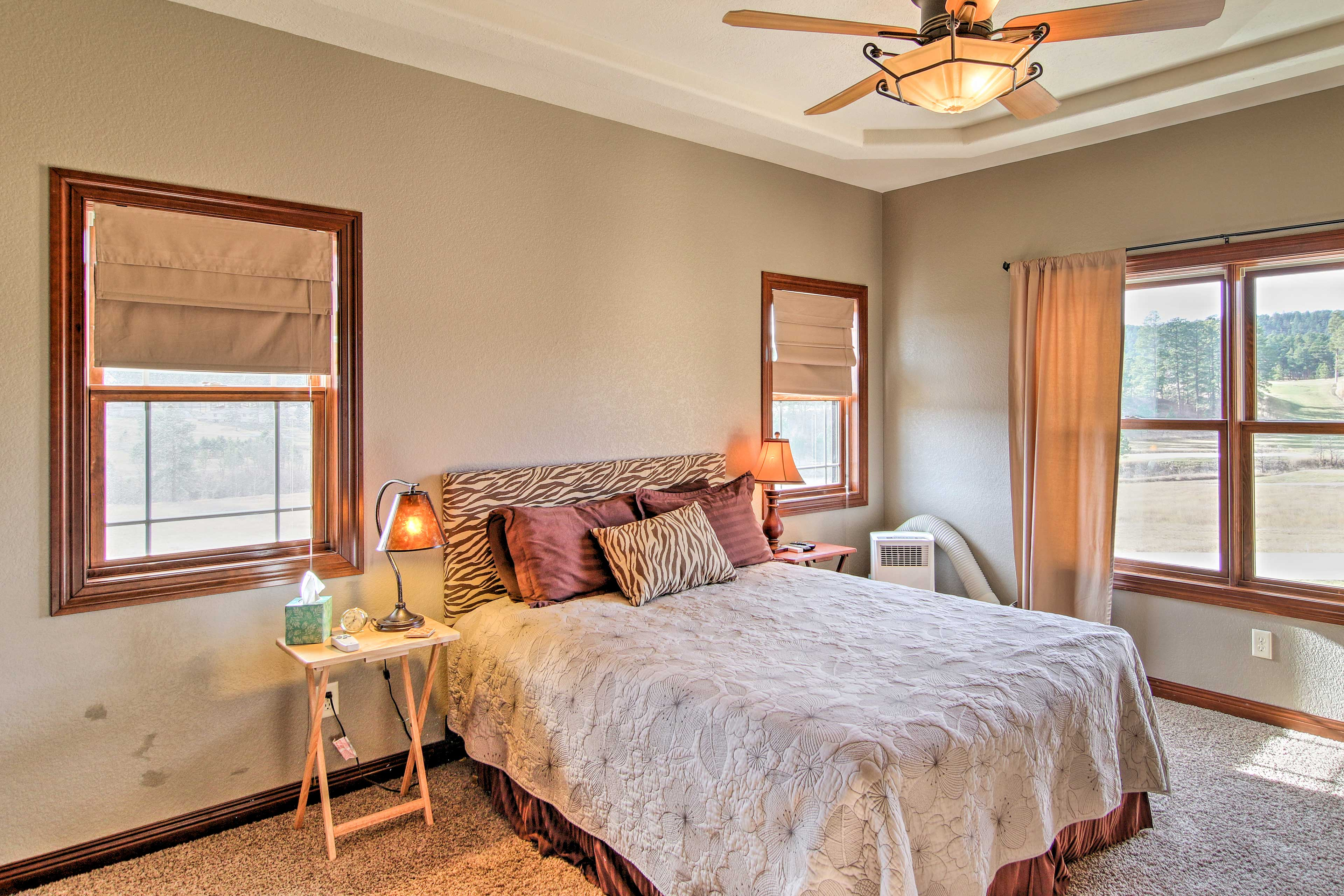 This bedroom boasts a comfortable king-sized bed.