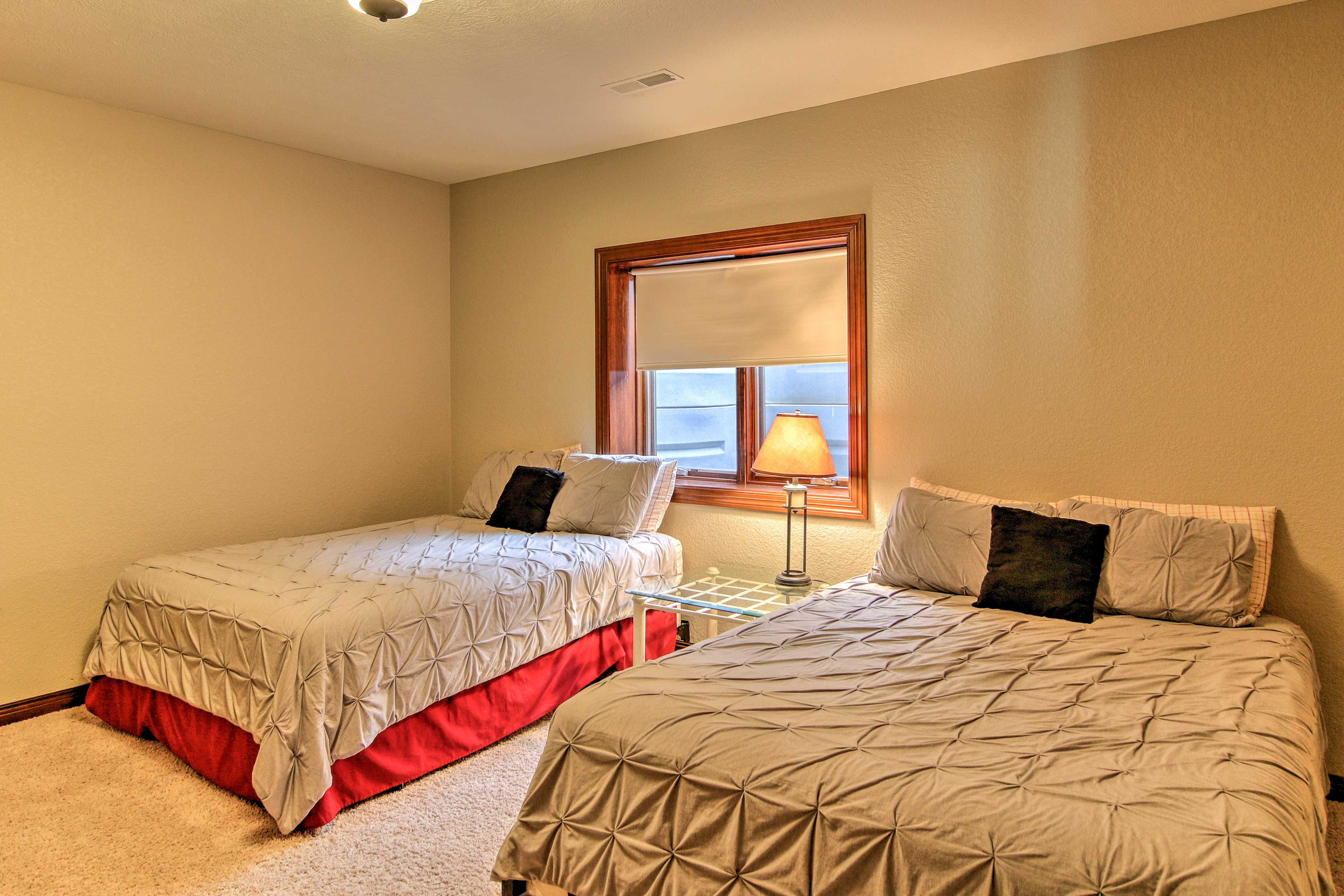 Up to 4 guests can share these 2 queen beds.