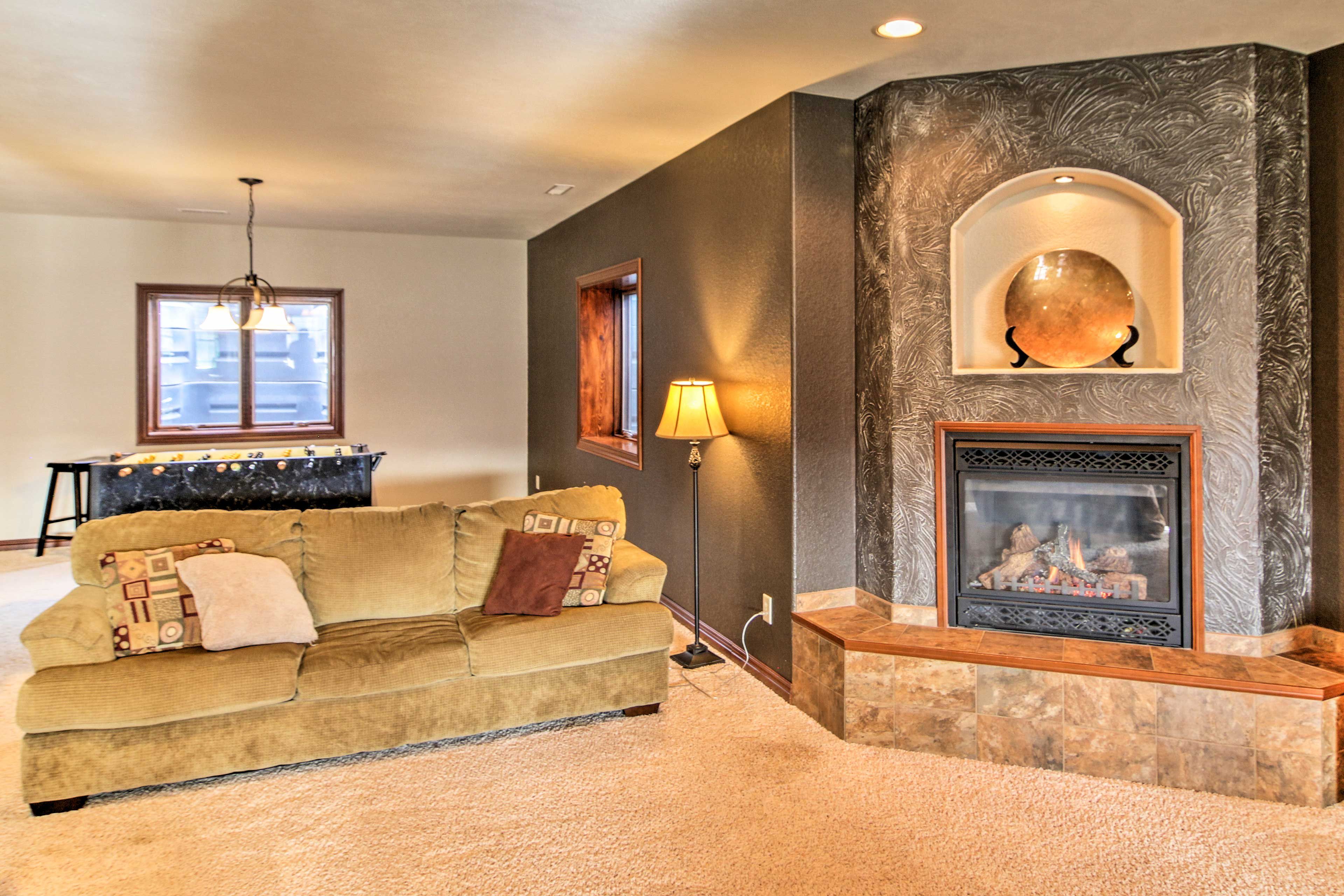 The 2nd living space in the lower level provides family-friendly entertainment.