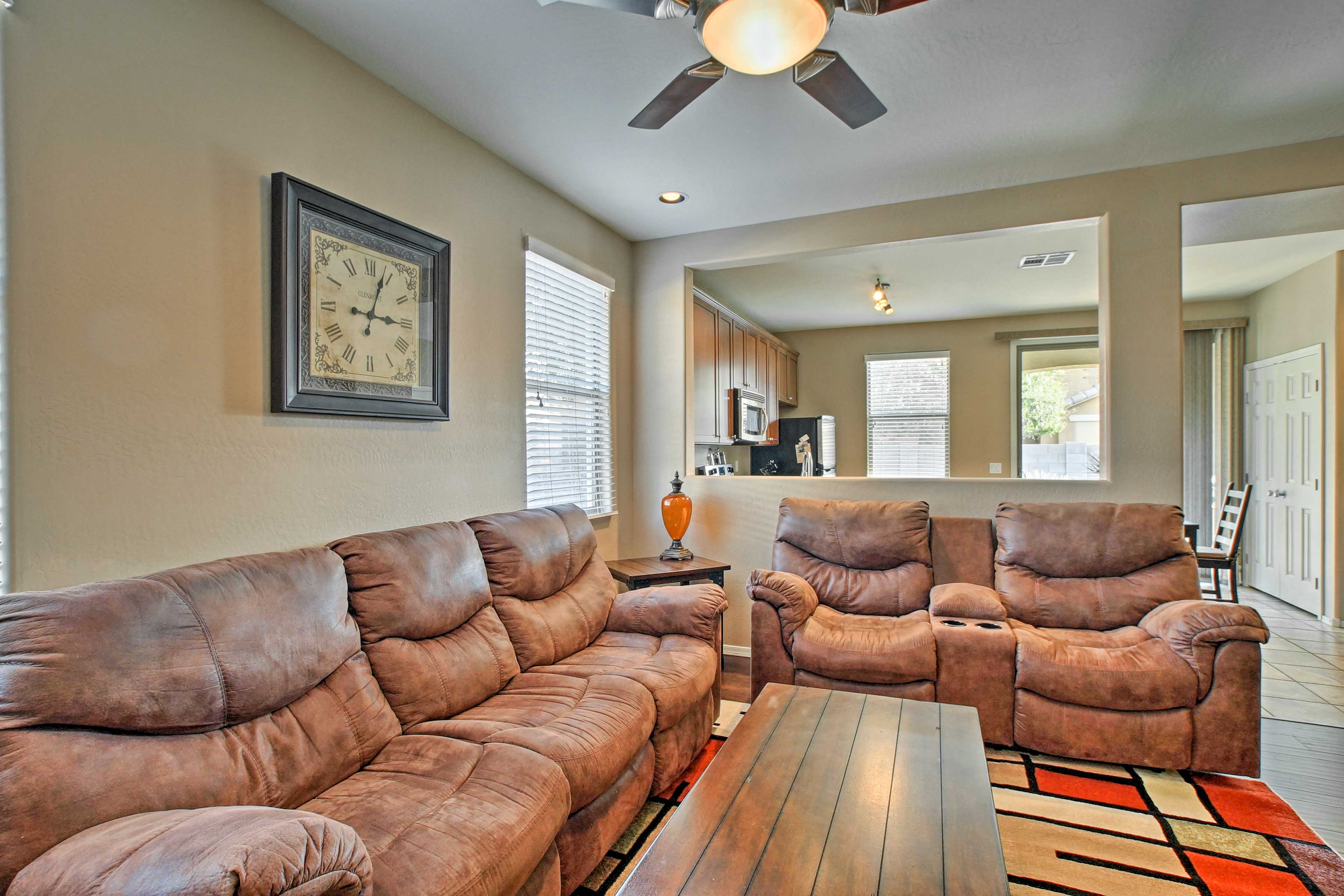 Settle into the leather sofa or matching love seat.