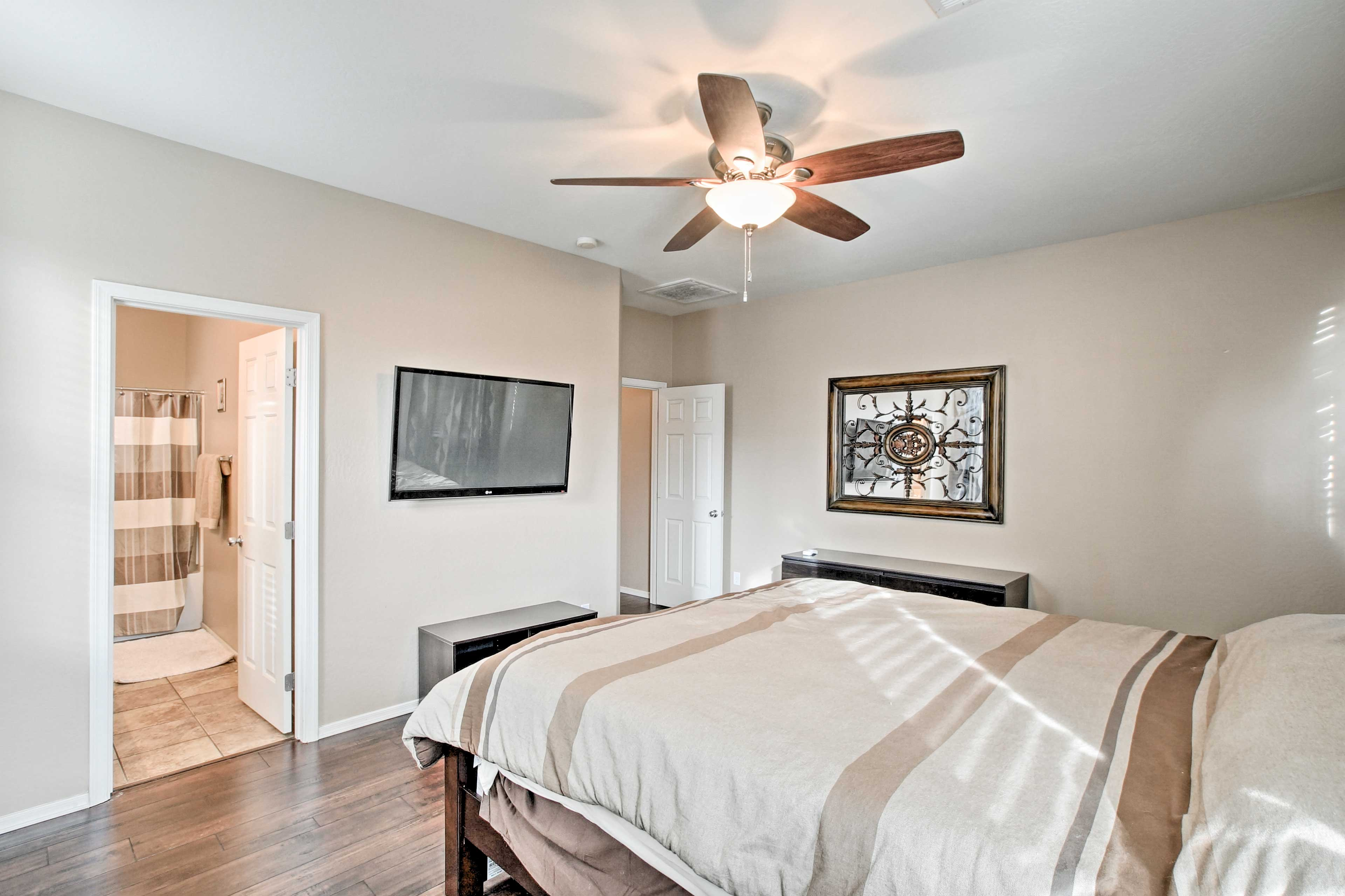 The master bedroom features a king-sized bed and en-suite bathroom.