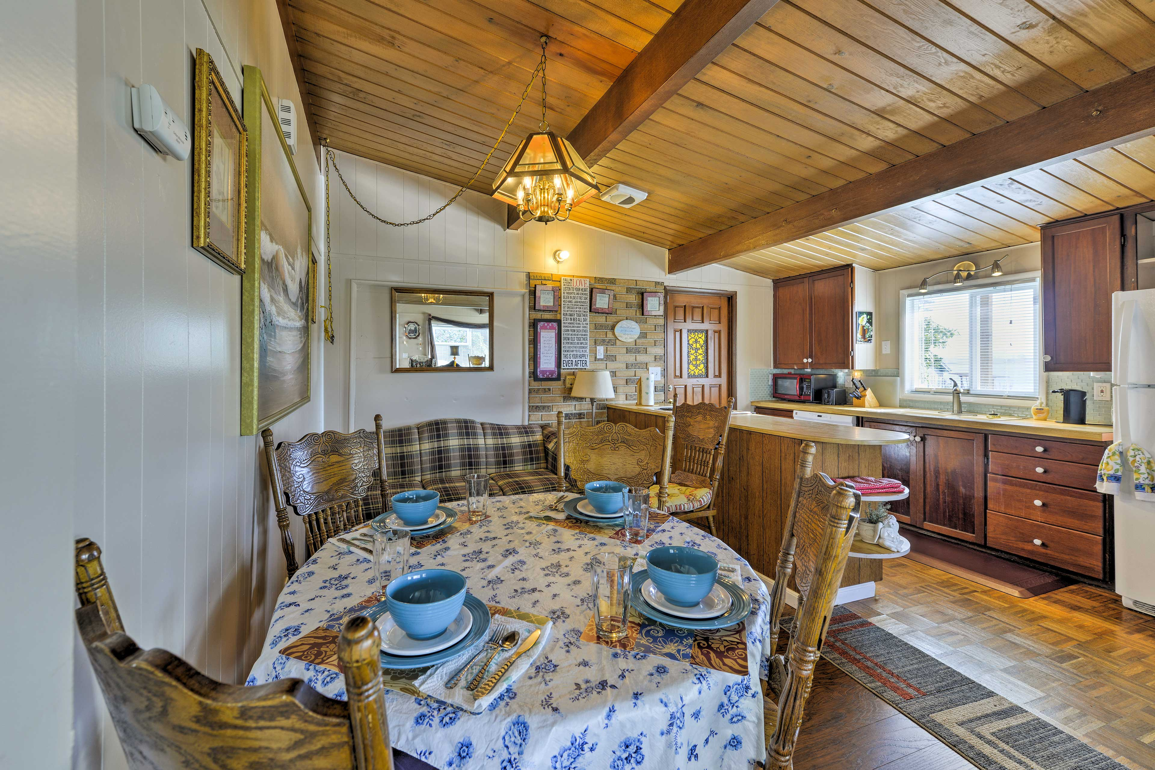 Gather around the 4-person kitchen table to savor meals.