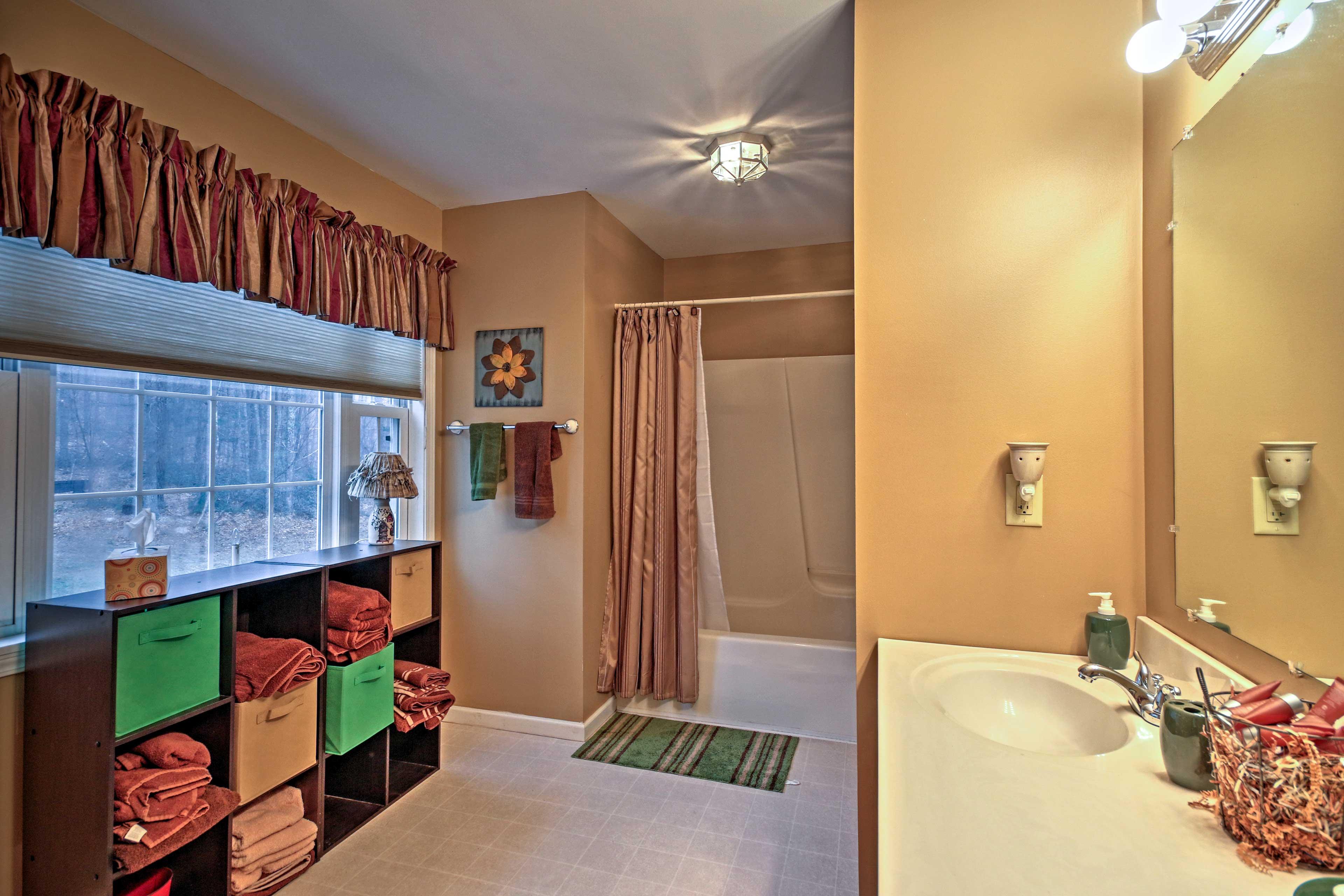 Enjoy freshening up in this spacious bathroom.
