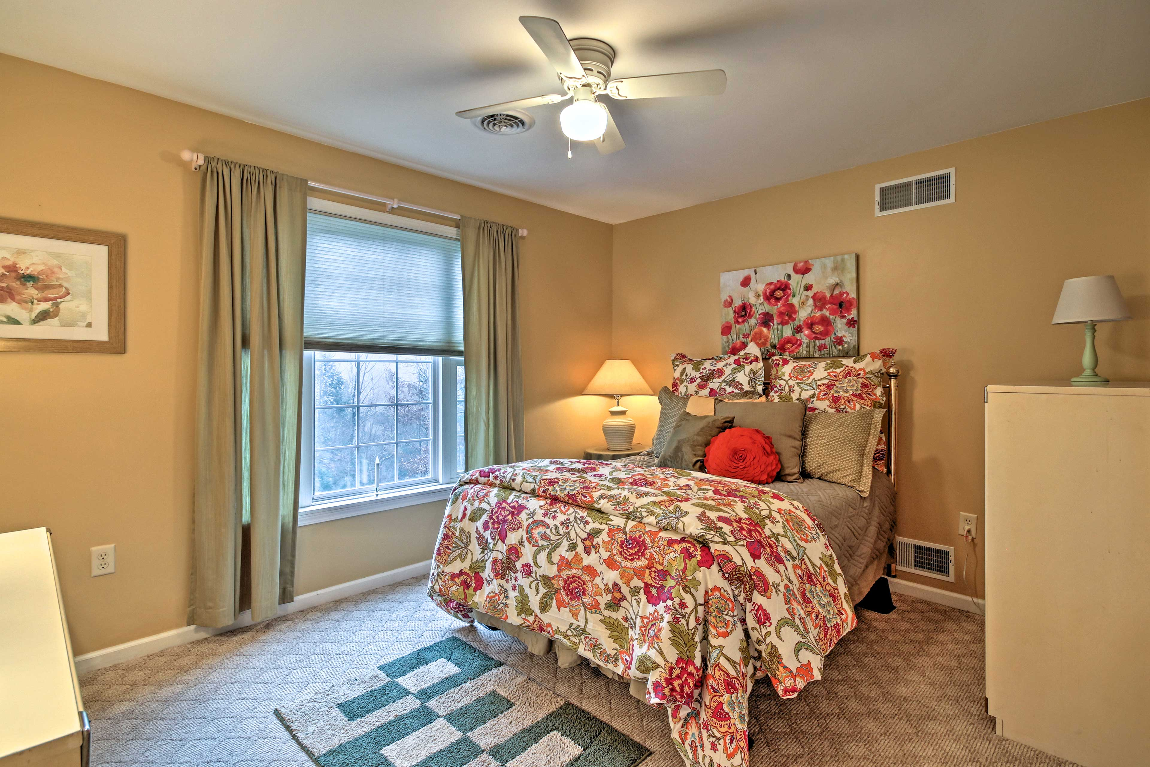 Bedroom 3 is complete with a cozy full bed.