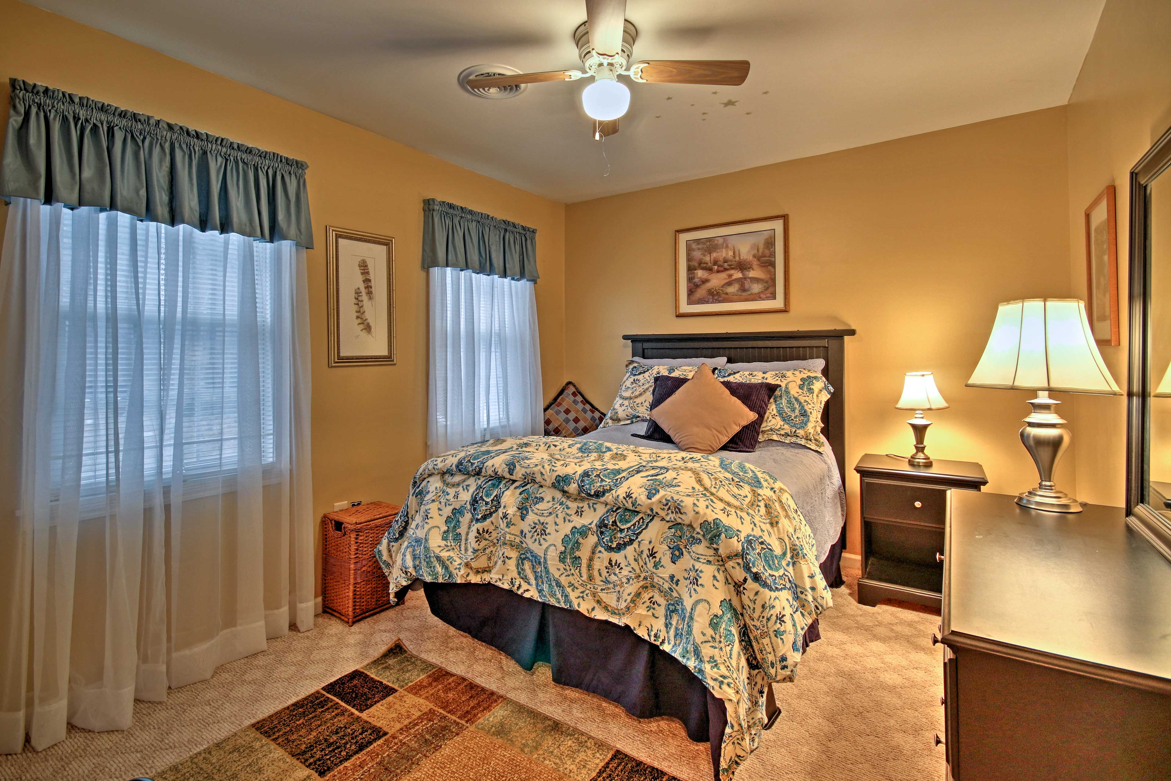 Sleep is sure to come easy in this last bedroom's full bed.