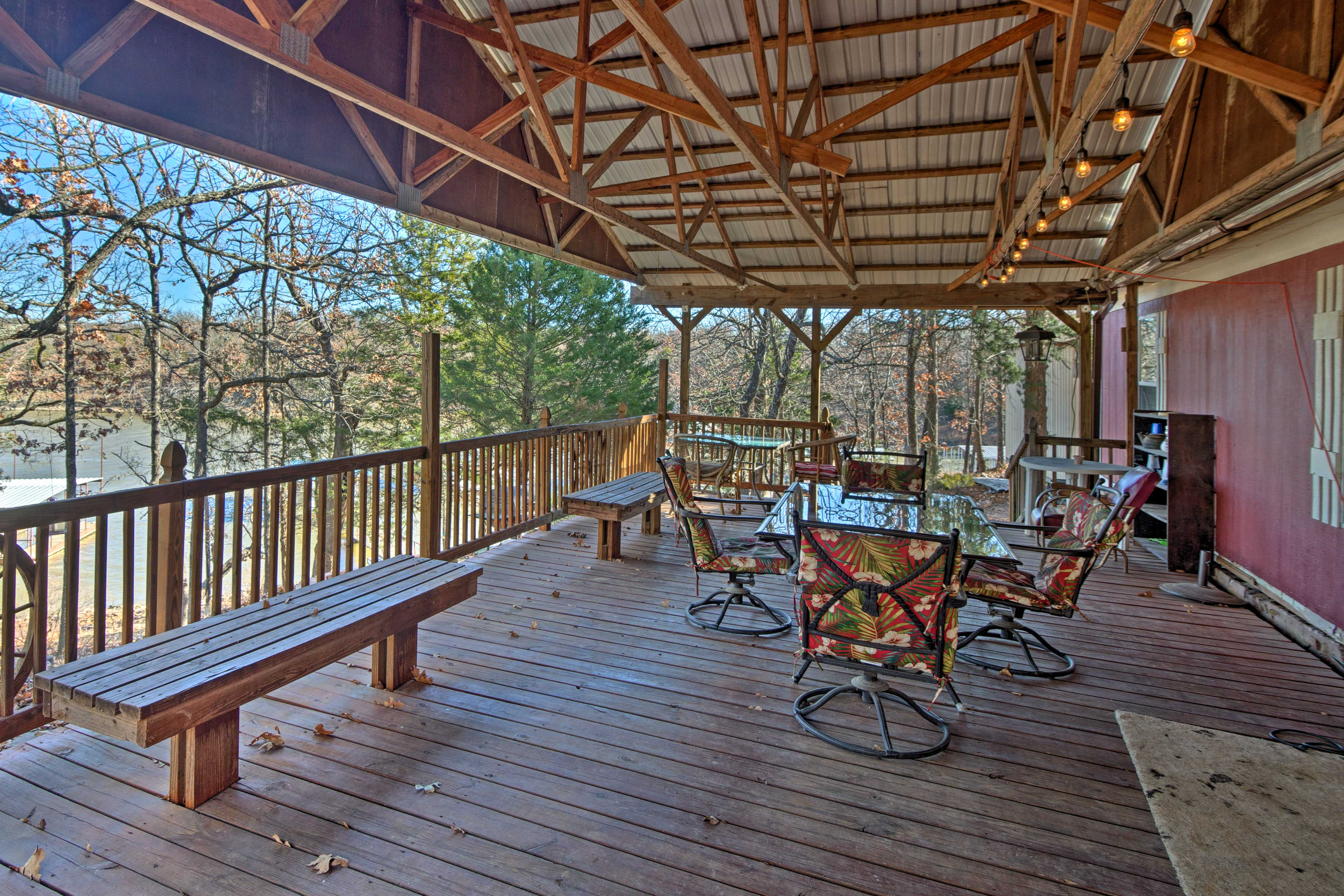 The property features a deck with outdoor seating and views of the lake.