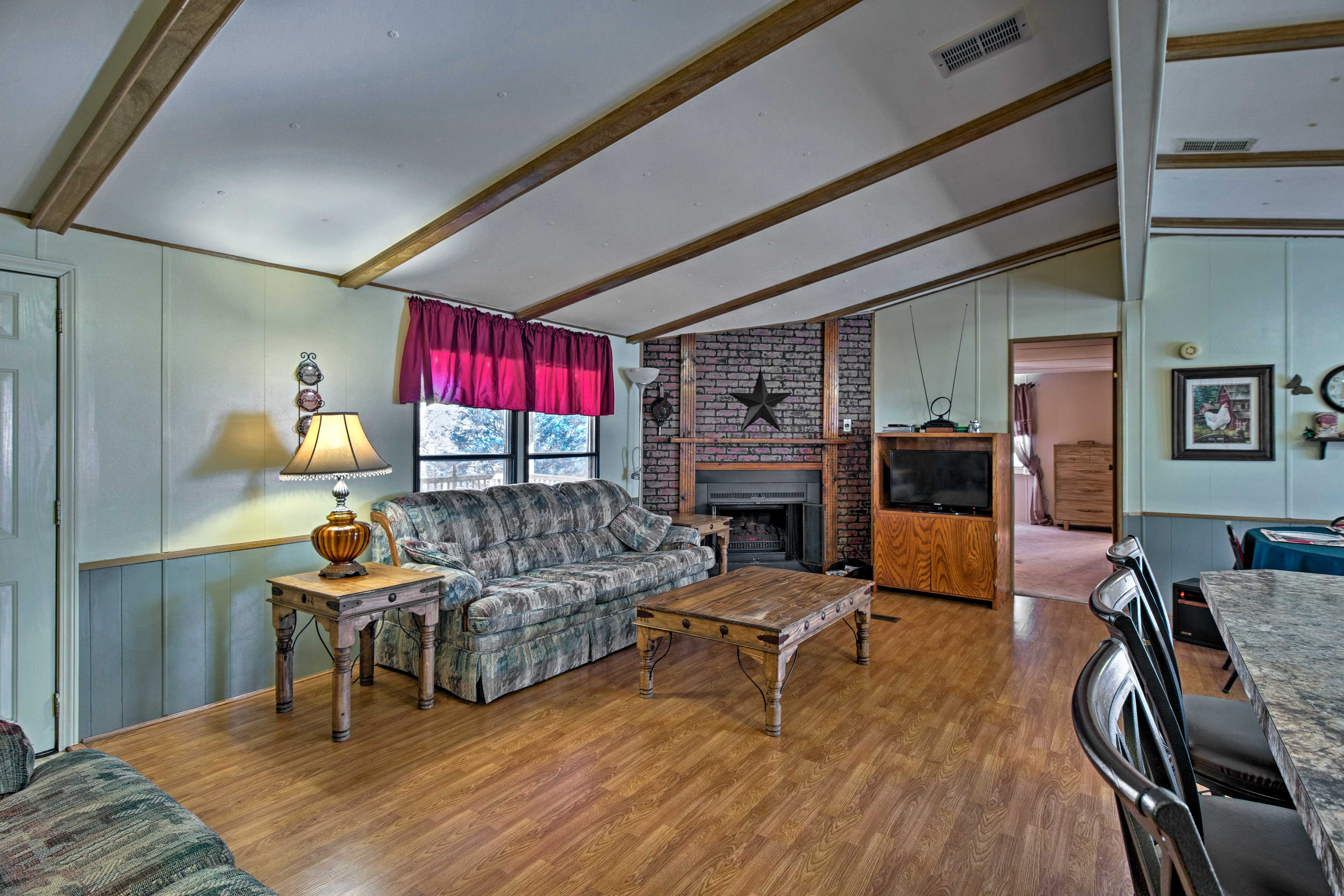 Inside, the home is well-appointed with comfortable furnishings.