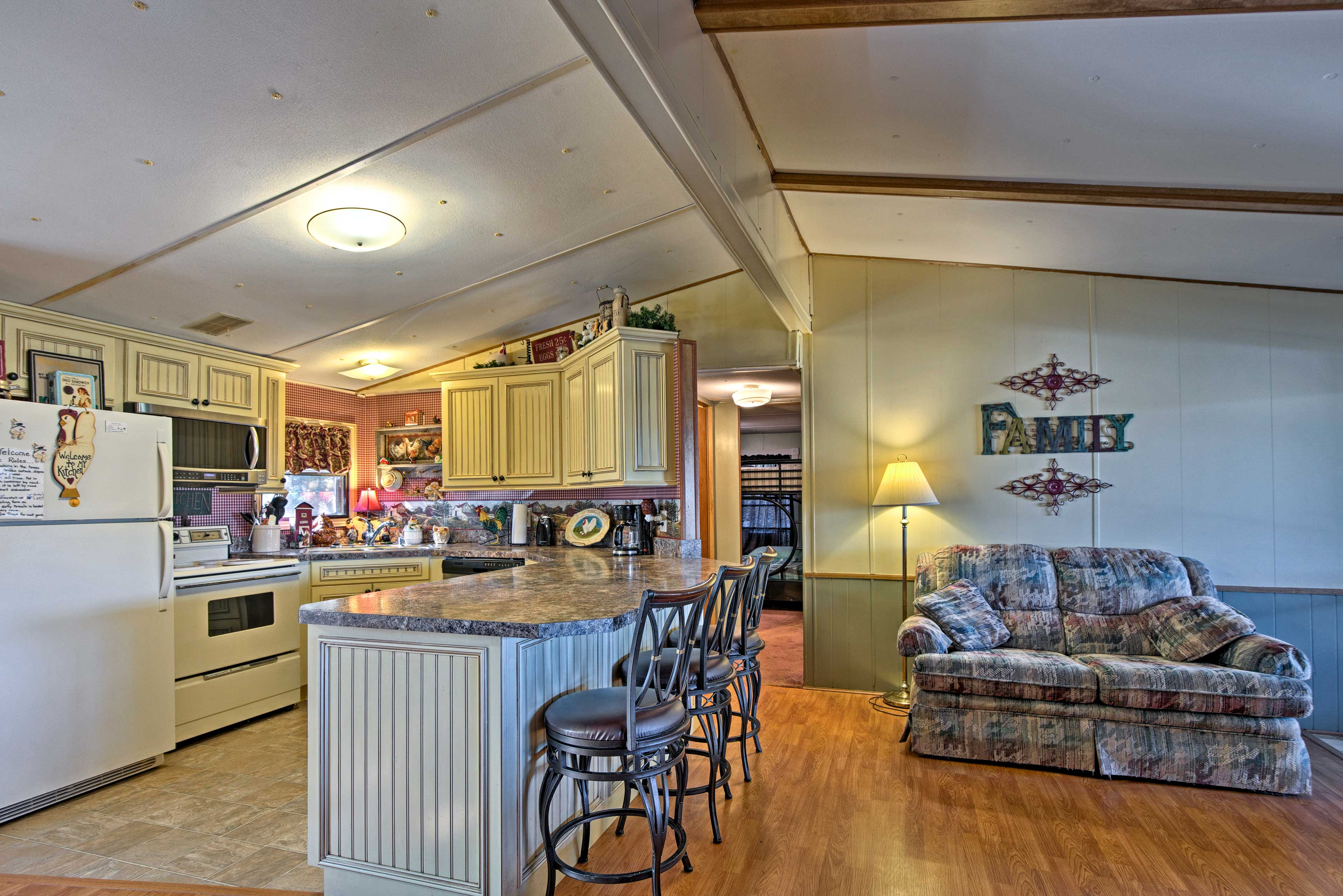 The living area flows into the fully equipped kitchen.
