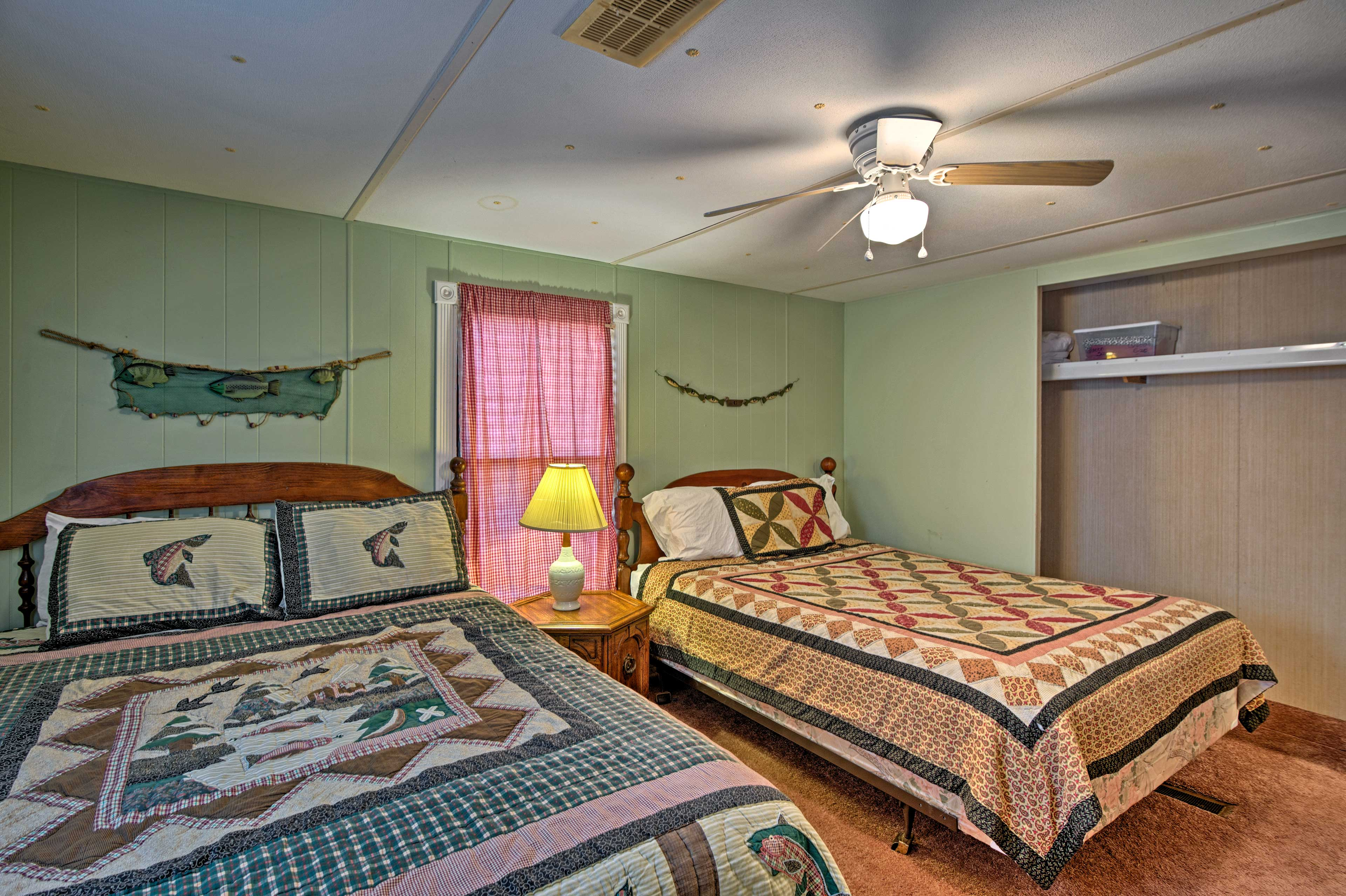This room offers a ceiling fan to keep you cool at night!