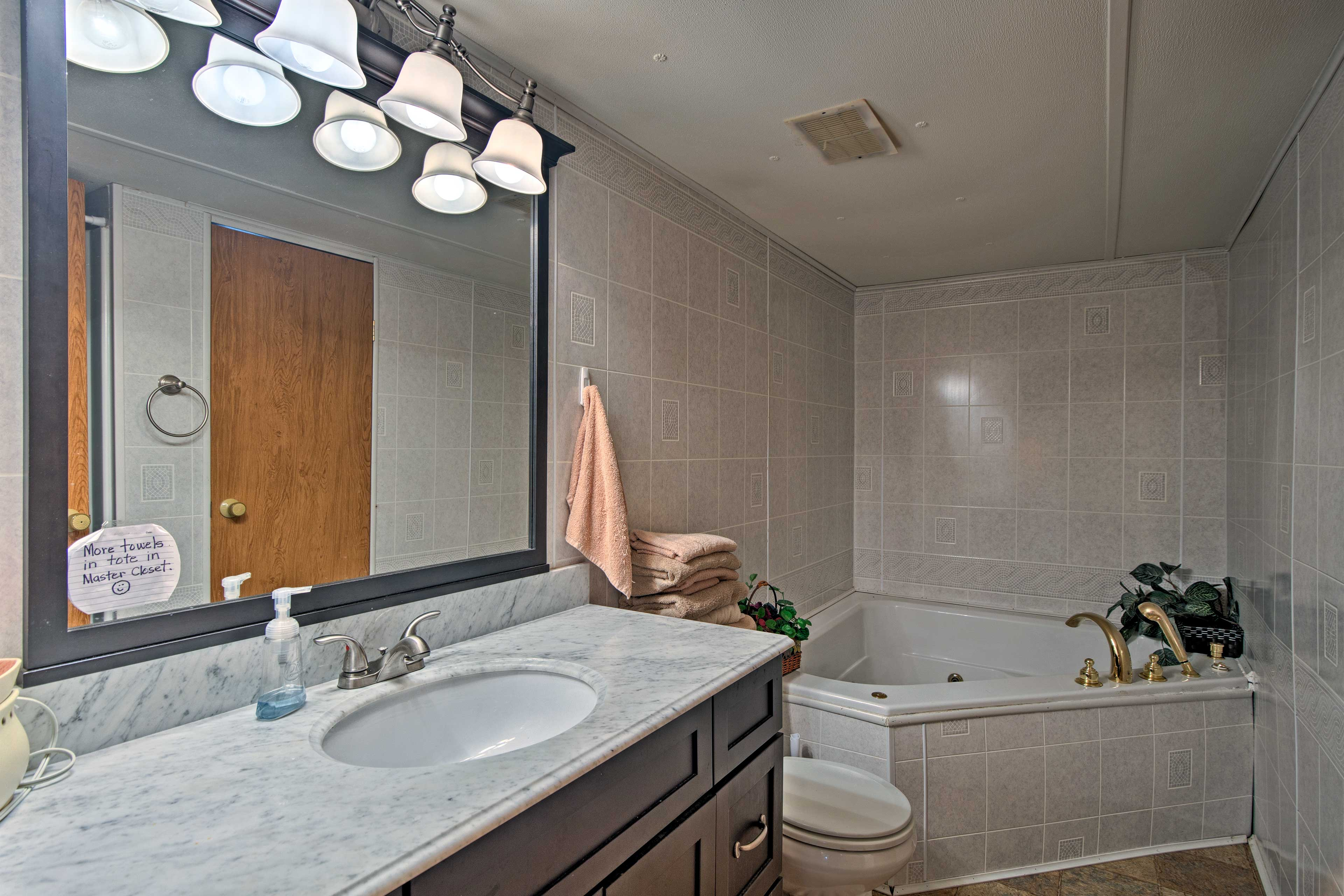 The en-suite master bathroom features a Jacuzzi tub and a walk-in shower.