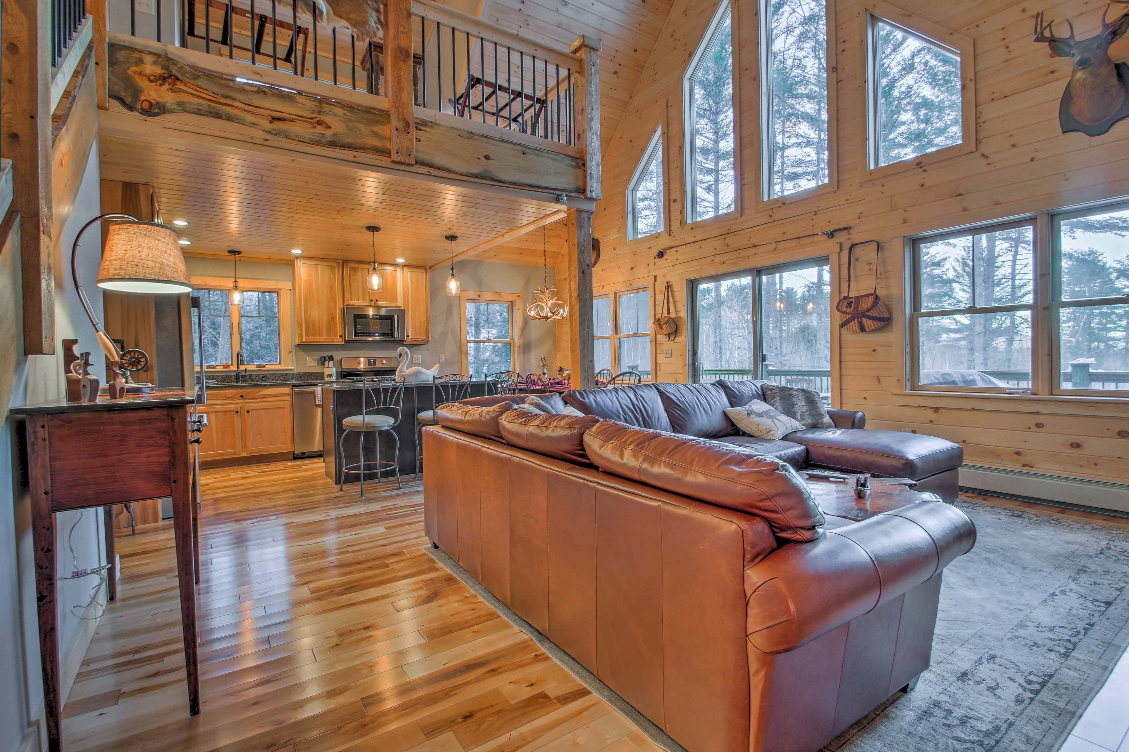 The tall vaulted ceilings and warm hardwood floors enhance the cozy atmosphere.