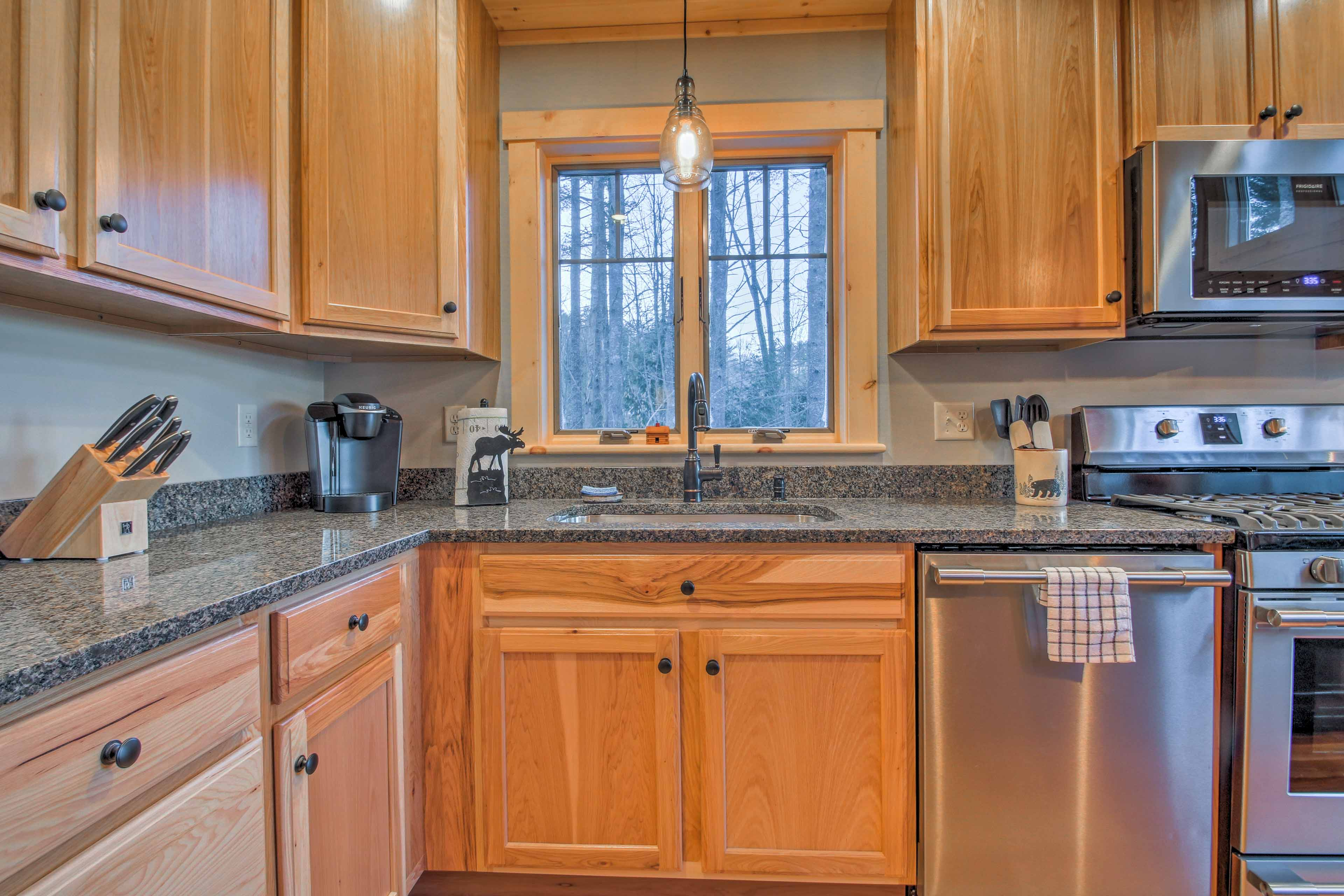 The fully equipped kitchen has stainless steel appliances and granite counters.