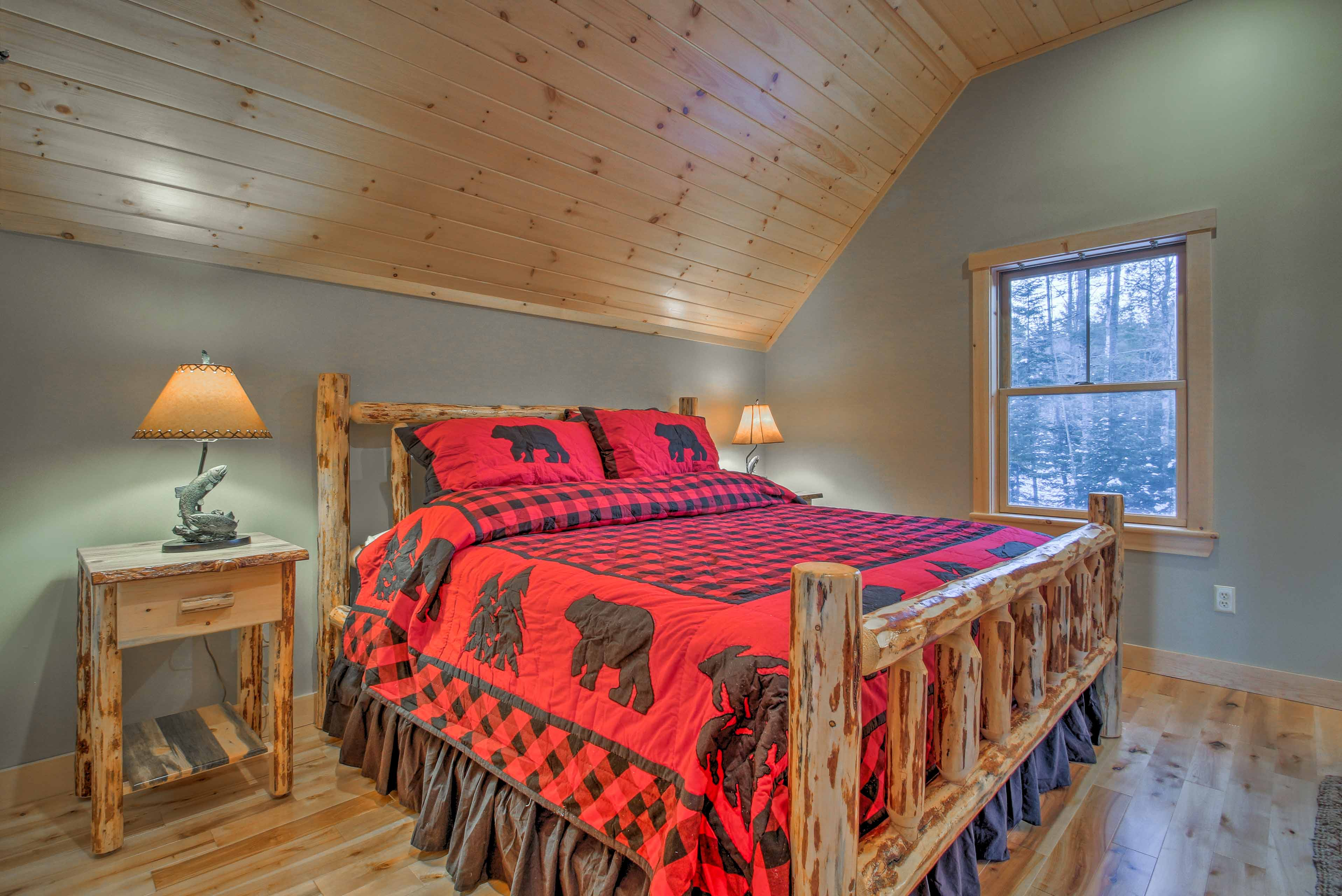 Decorated with Northwoods bedding, this king bed offers peaceful slumbers.