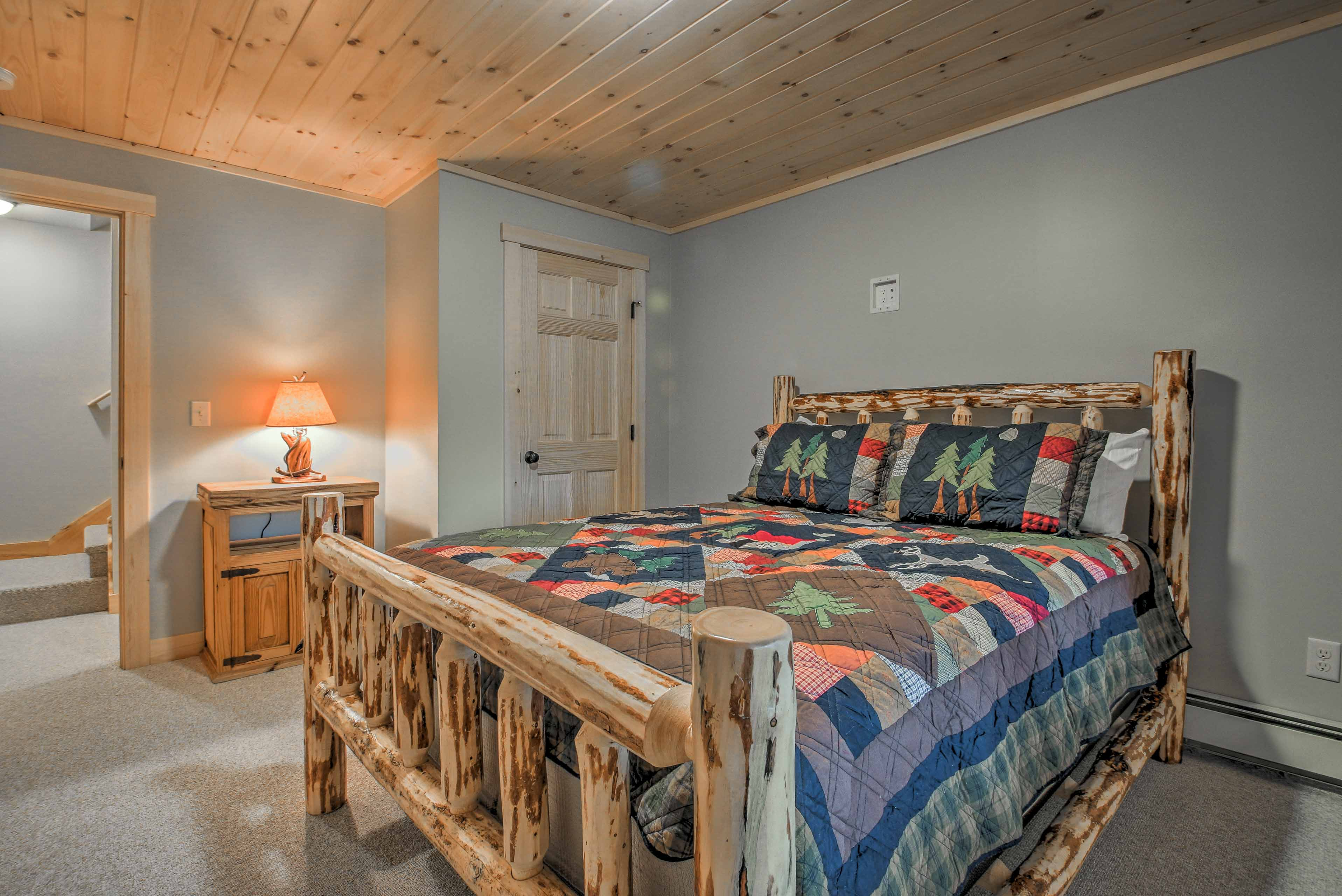 Two travelers can cozy up and drift off to sleep in this comfortable queen bed.