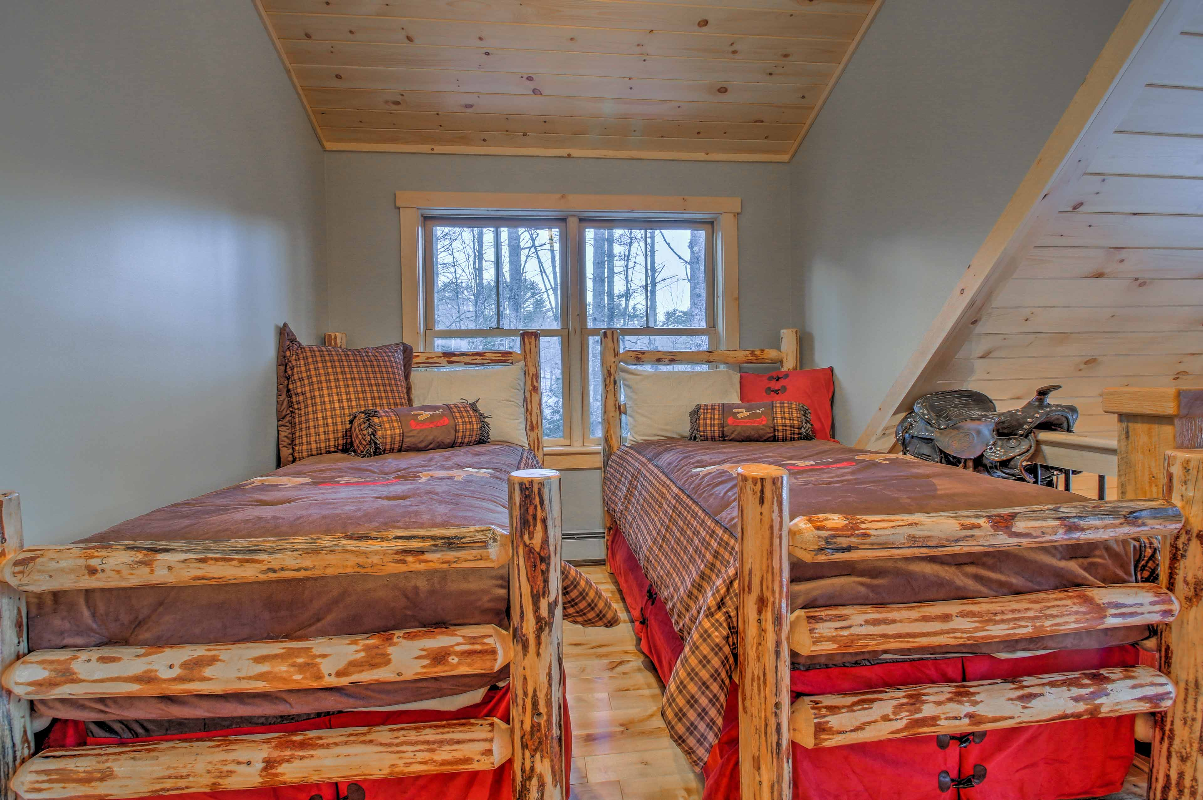 You'll find 2 twin beds under the pine-paneled vaulted ceilings.