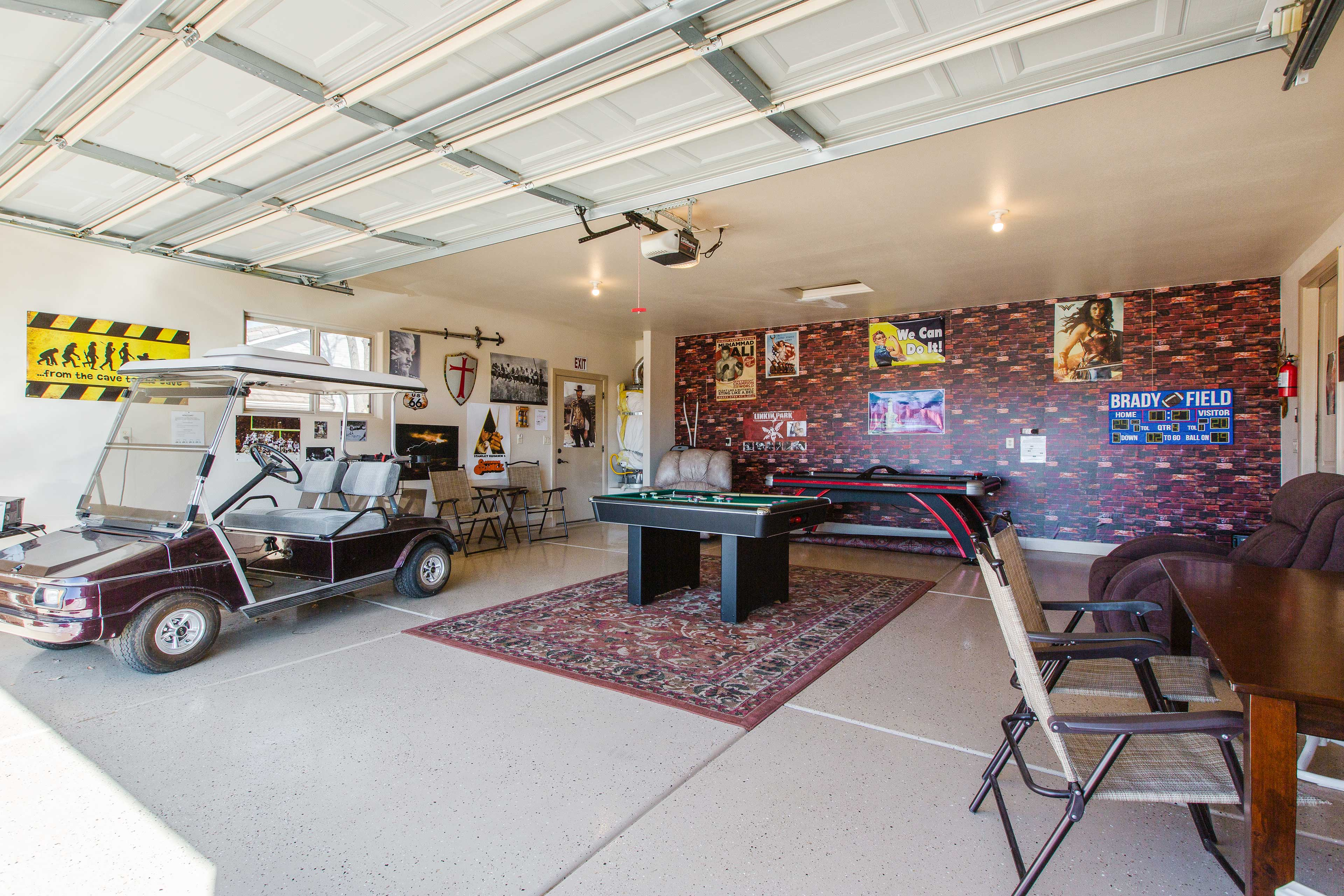 The garage includes a bumper pool table and air hockey table!