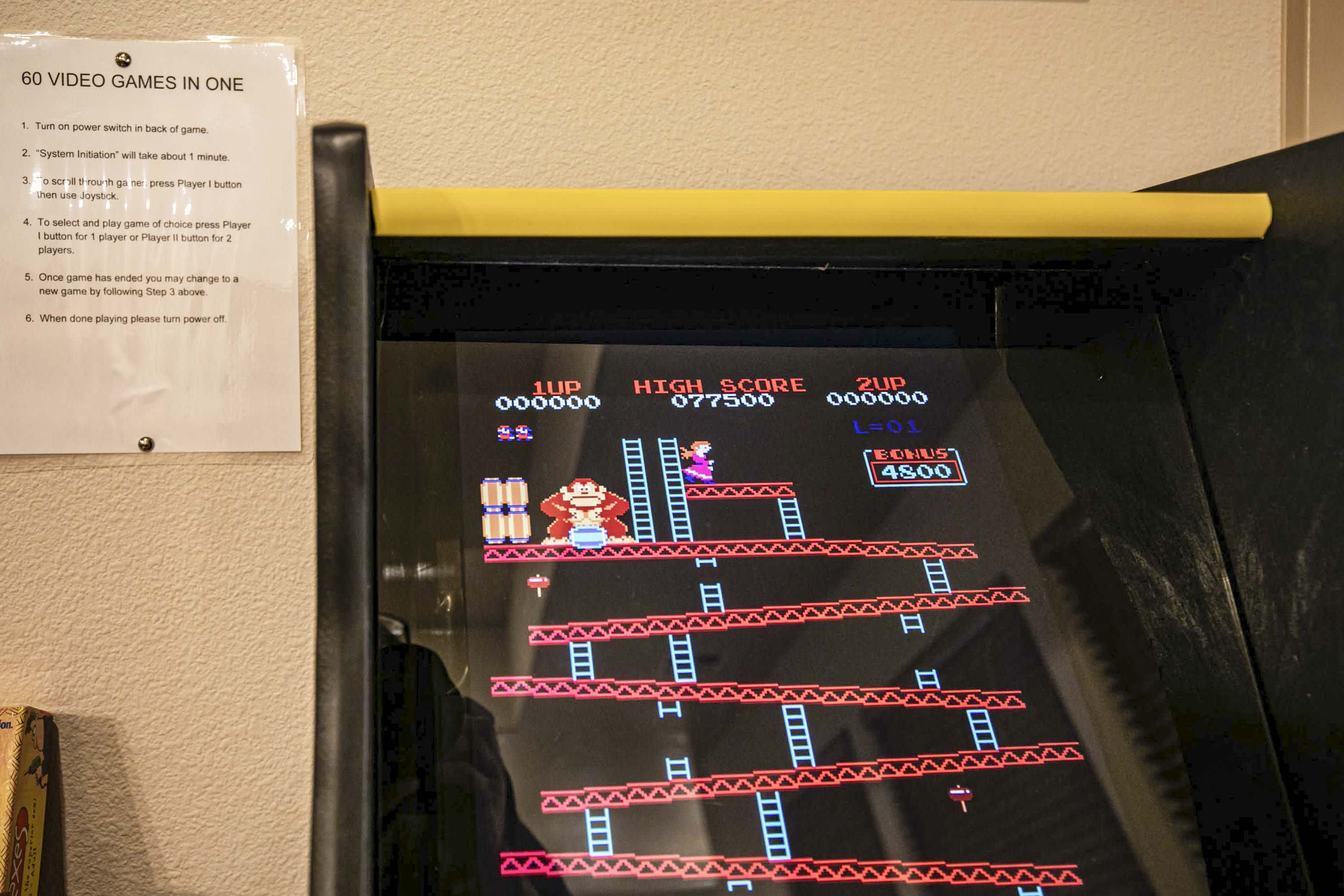 The adults in the group may feel some nostalgia playing the arcade game.