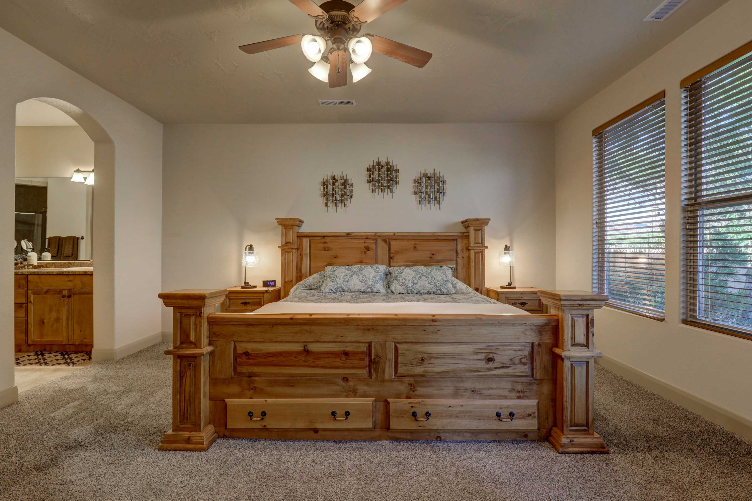 The master bedroom features a lavish king-sized bed.