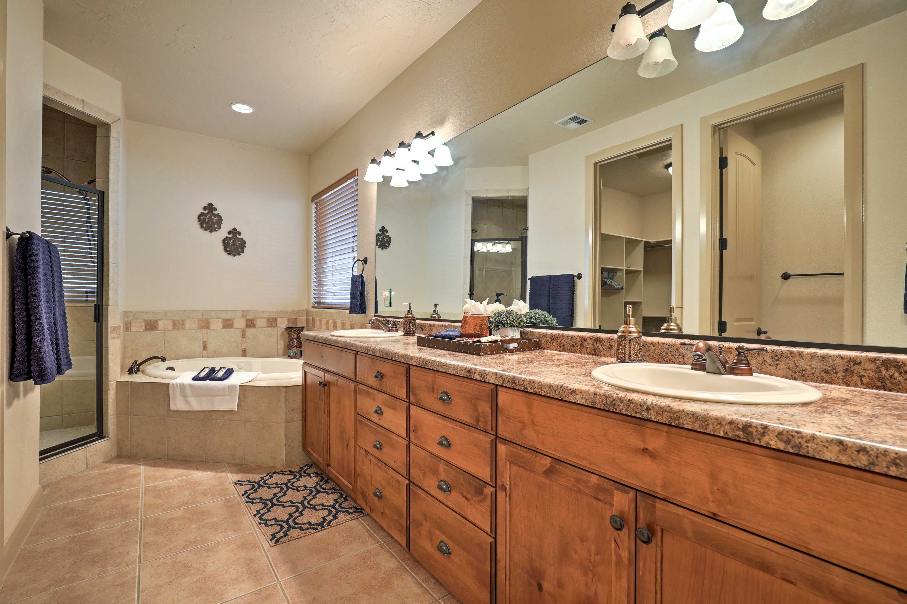 Find a walk-in shower and soaking tub in the en-suite bathroom.