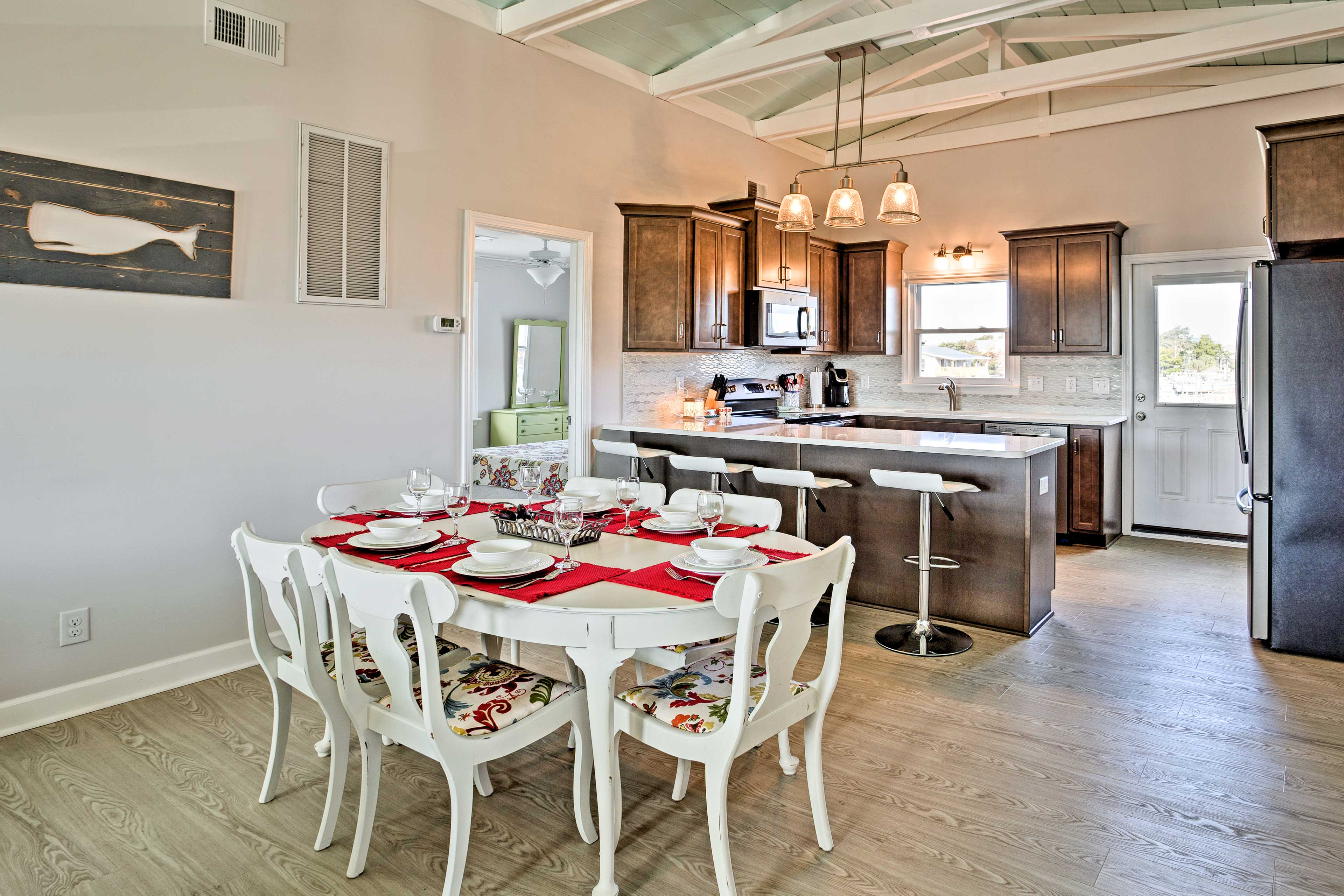 Upstairs, the home boasts another living, kitchen, and dining area.