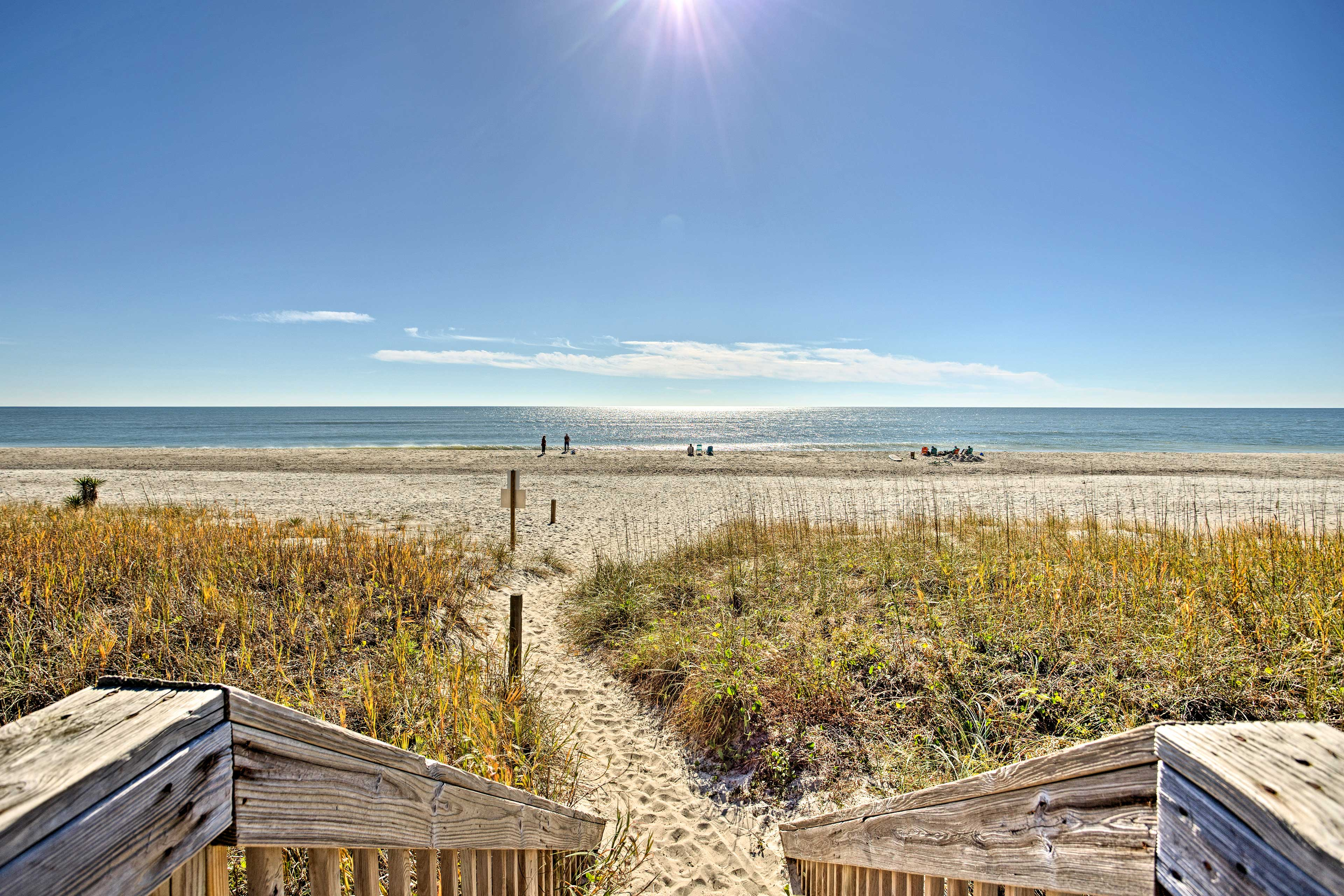 Dip your toes in the sand right across the street from this Holden Beach home!