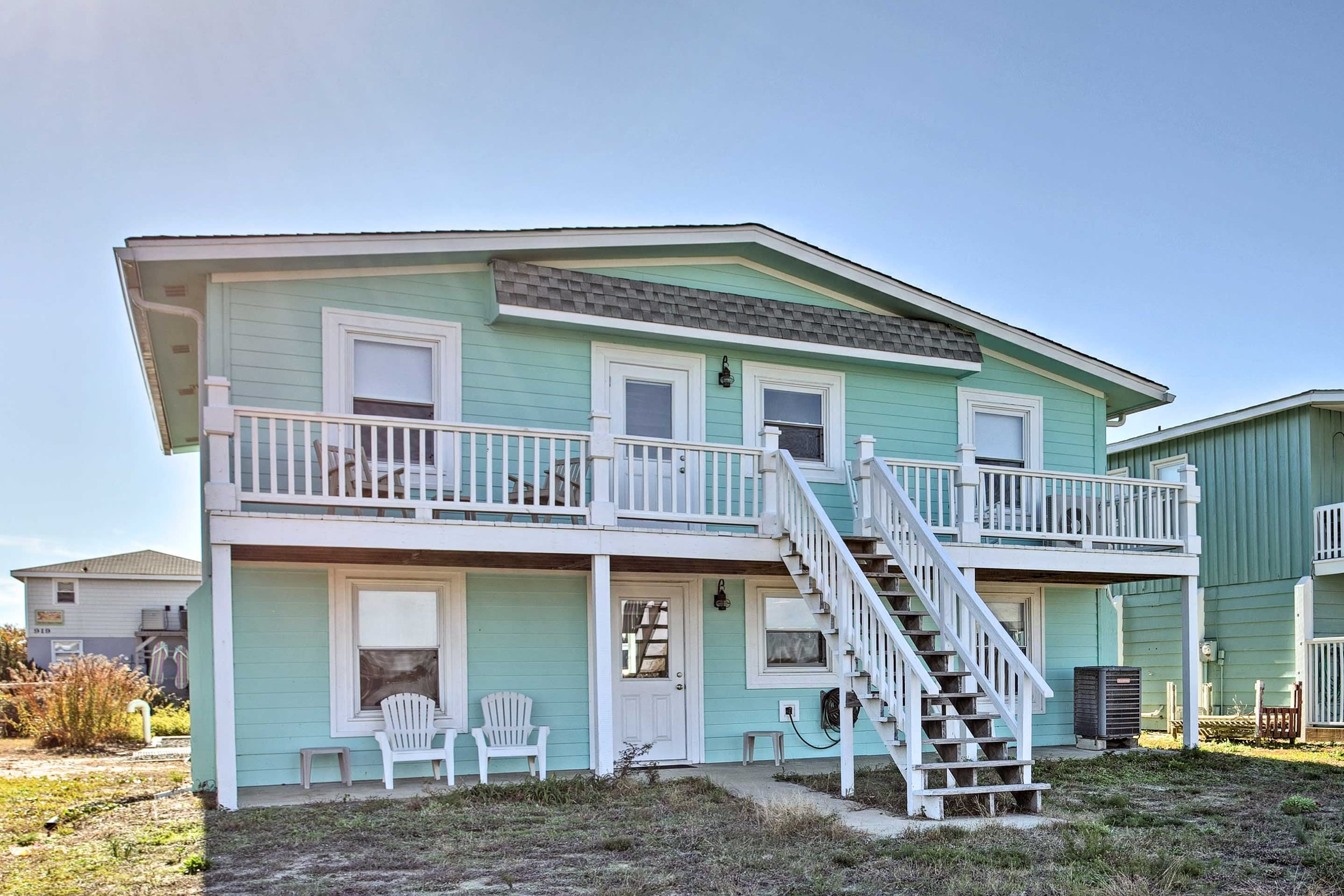 Escape to the beach at this 7-bedroom, 4-bath vacation rental in Holden Beach!