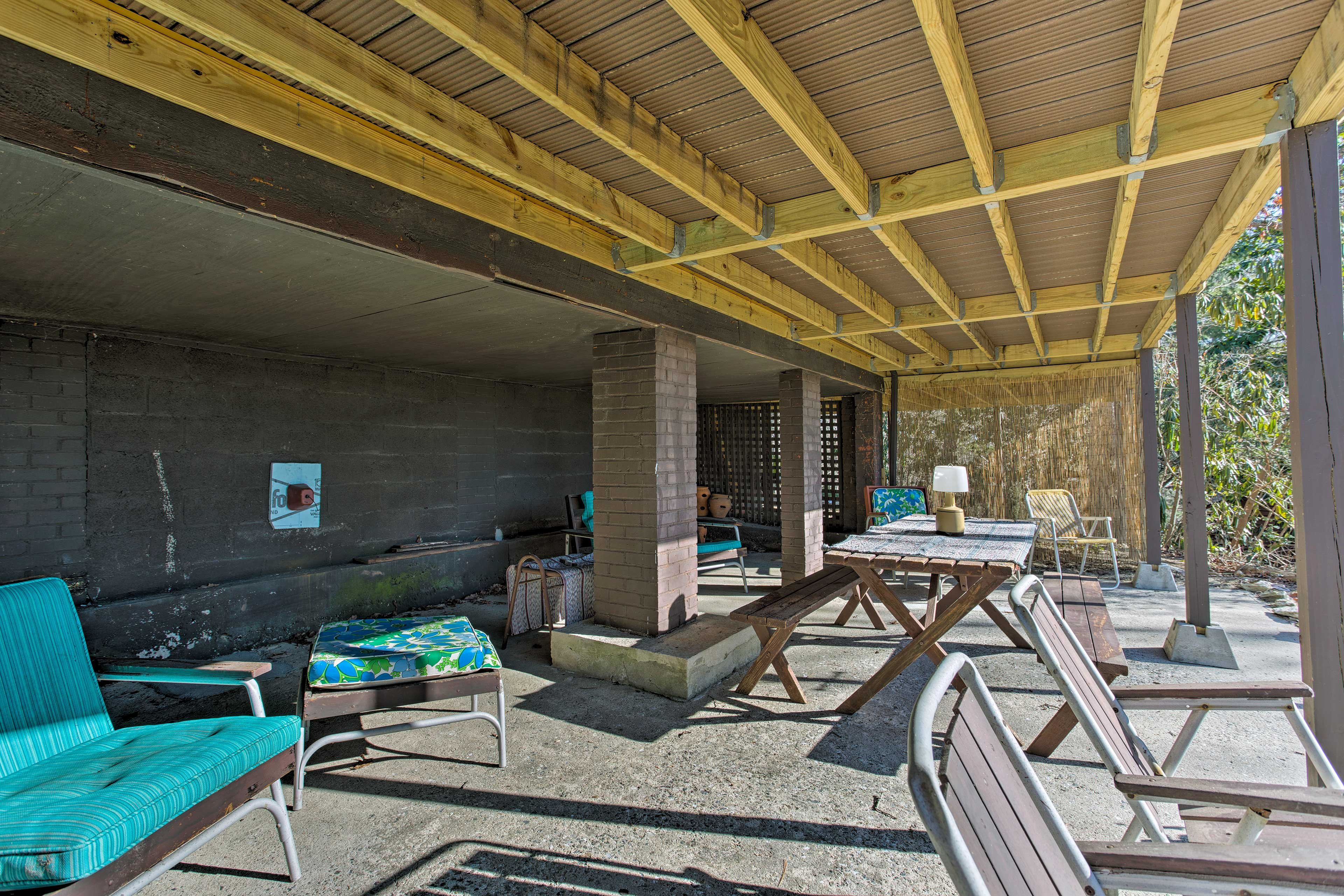 Additional outdoor seating is found just underneath the shade of the deck.