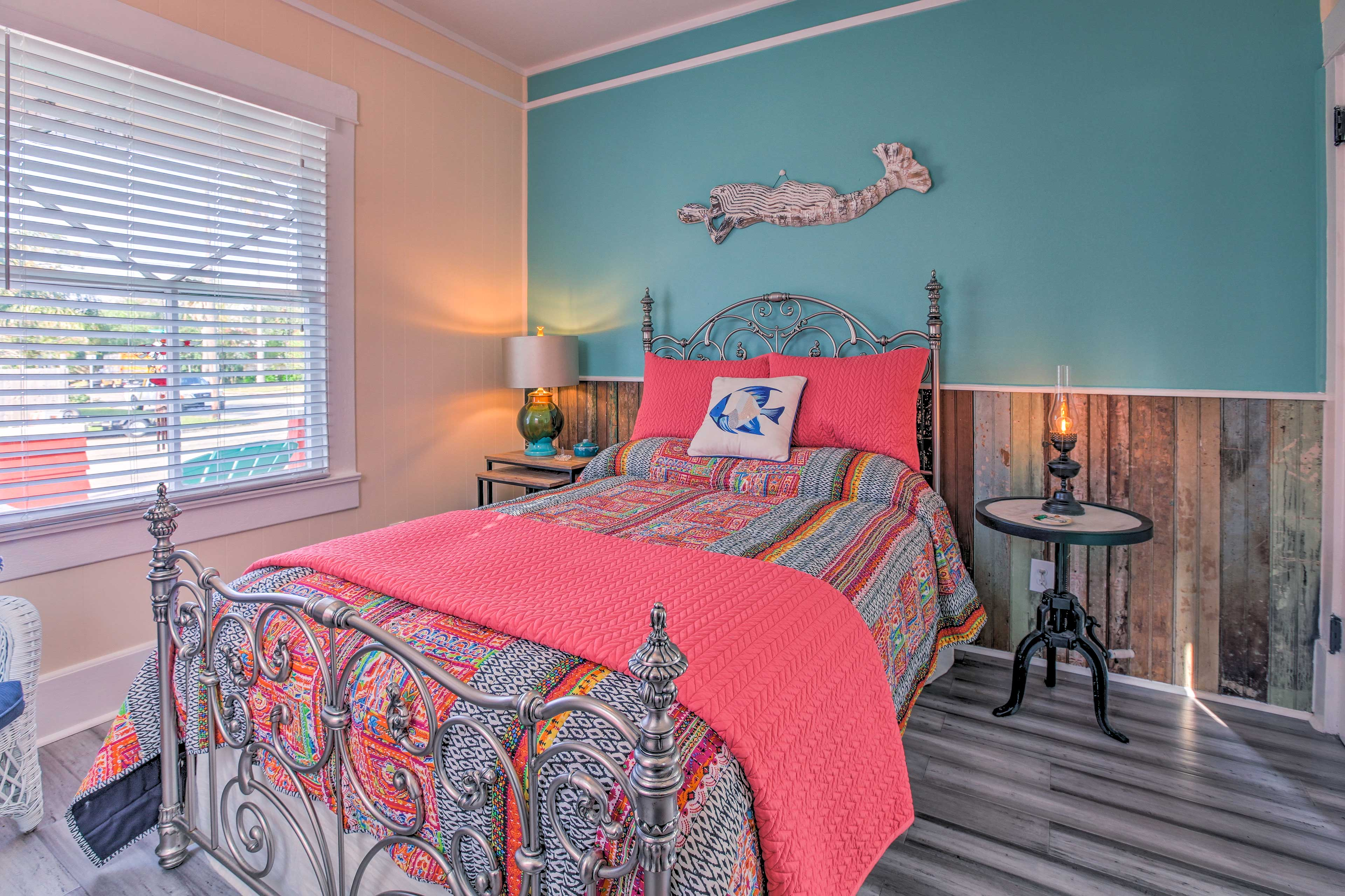 Vibrant colors invite you into the second bedroom featuring a full bed.