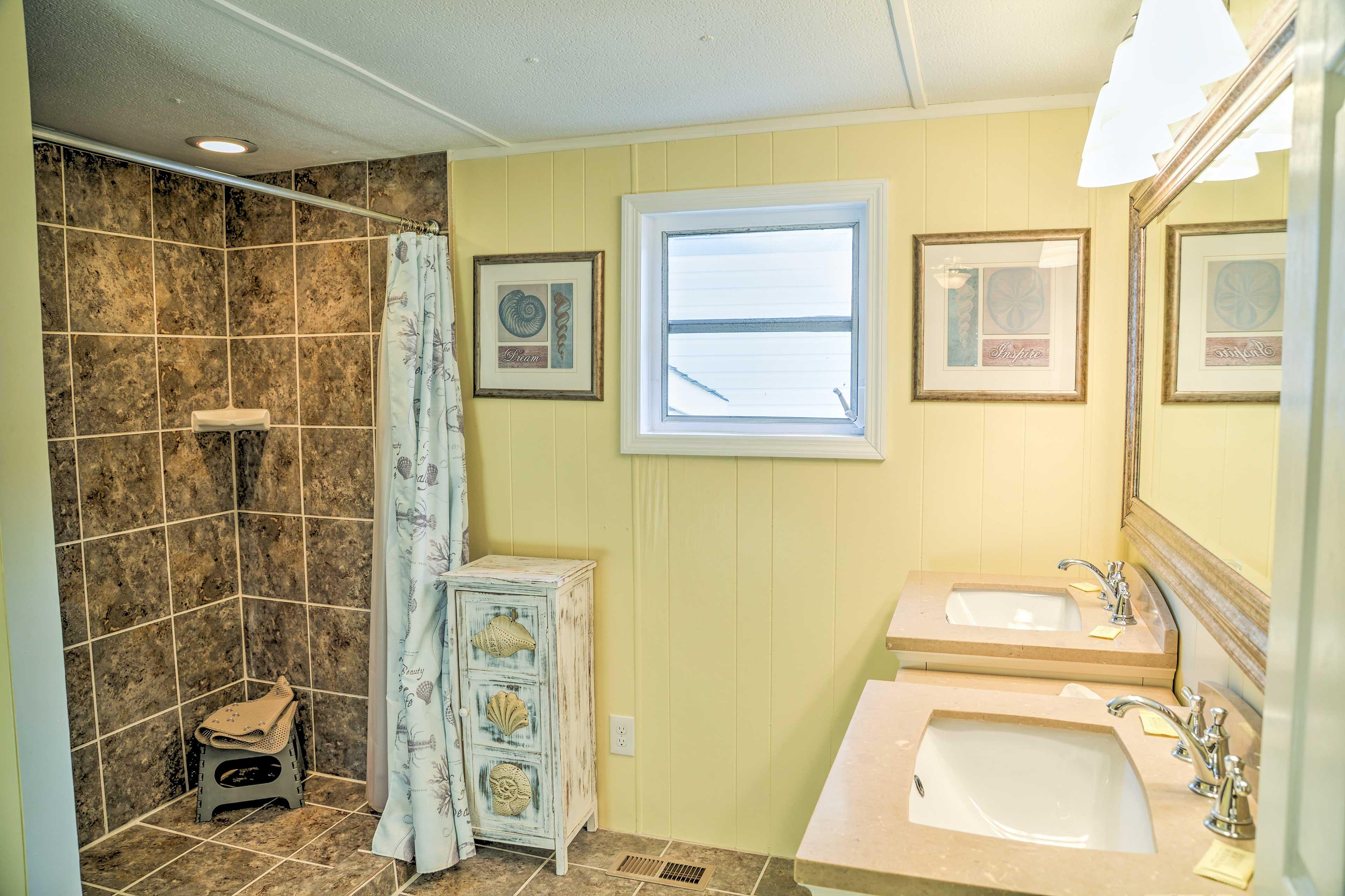 The master en-suite bathroom provides 2 separate vanities and a walk-in shower.