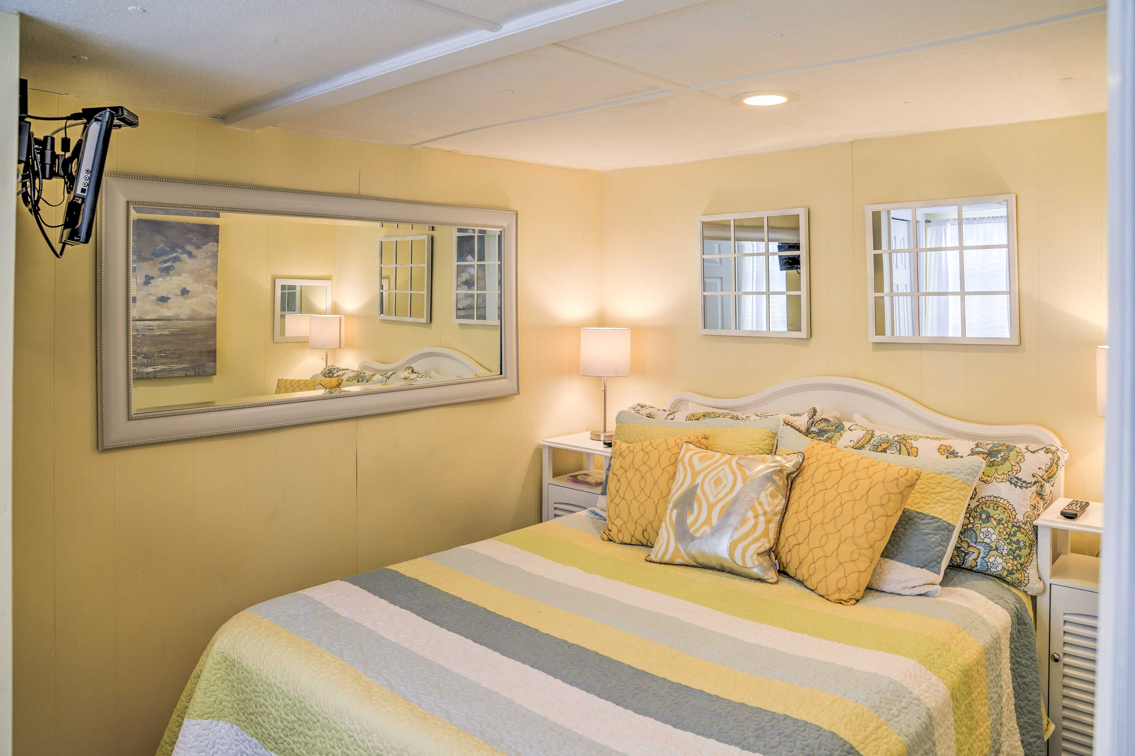 Two travelers will cozy up in this queen bed in the second bedroom.