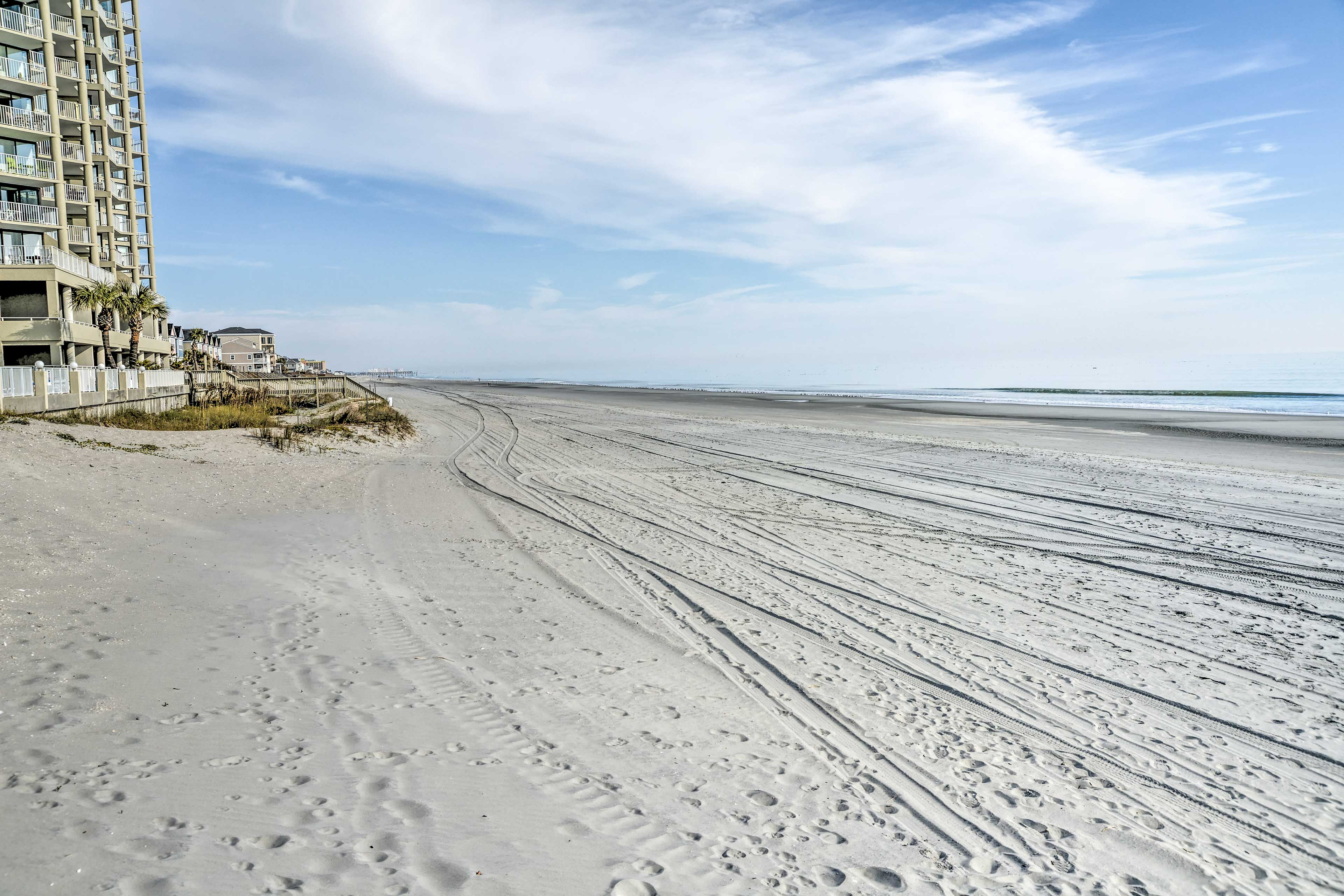 White sandy beaches await just 200 steps from this home!