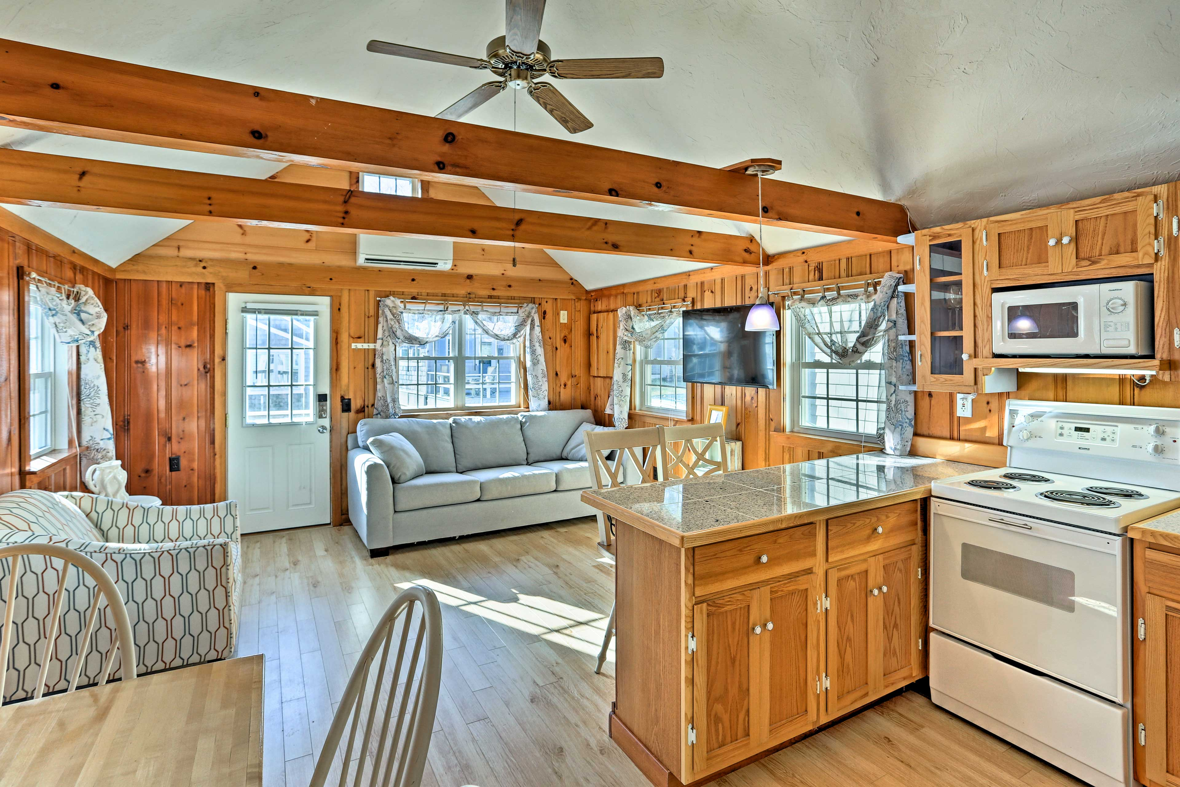Inside you'll find a quaint cabin-like space brimming with Cape Cod charm.