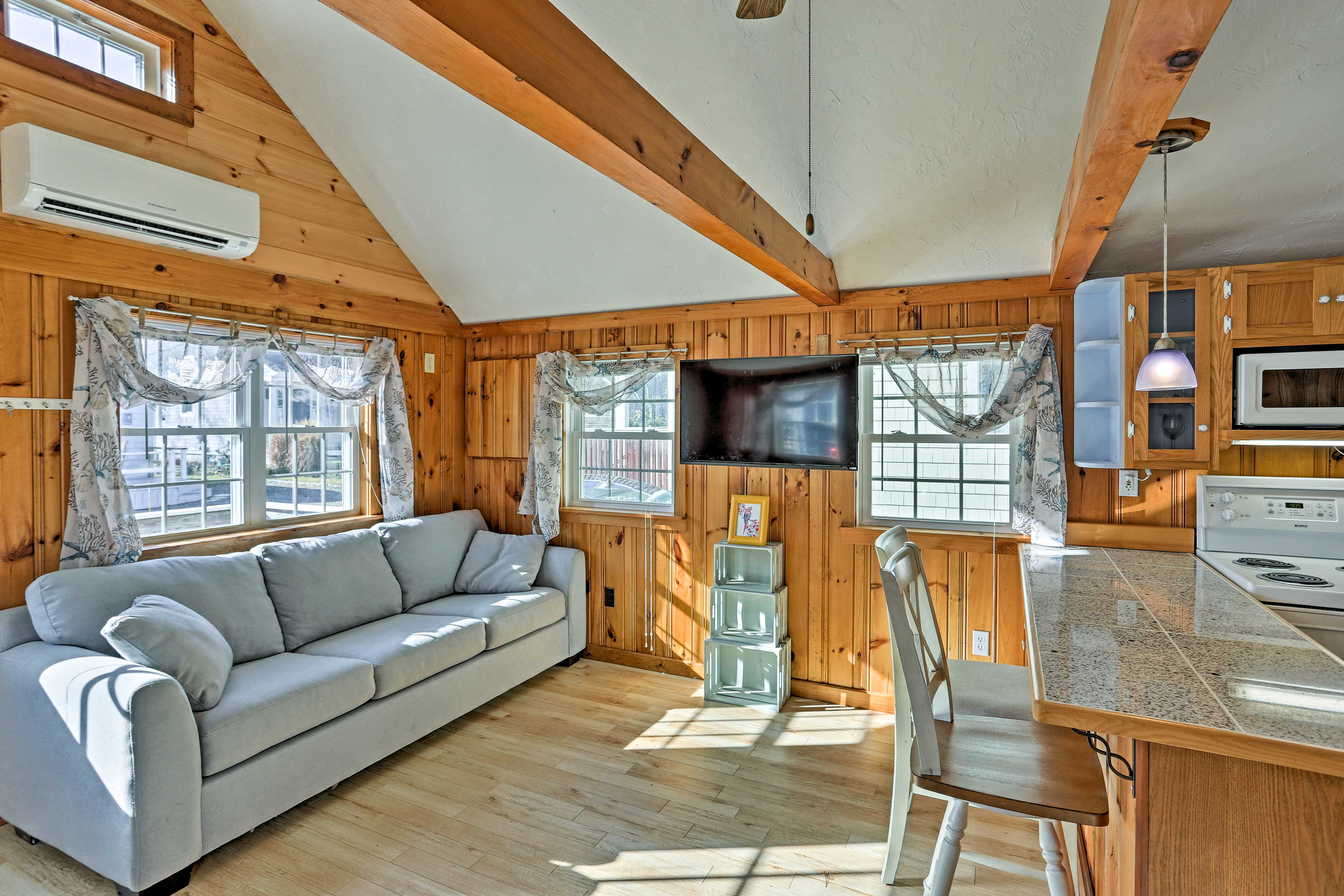 Natural light pours in through the large bay windows.