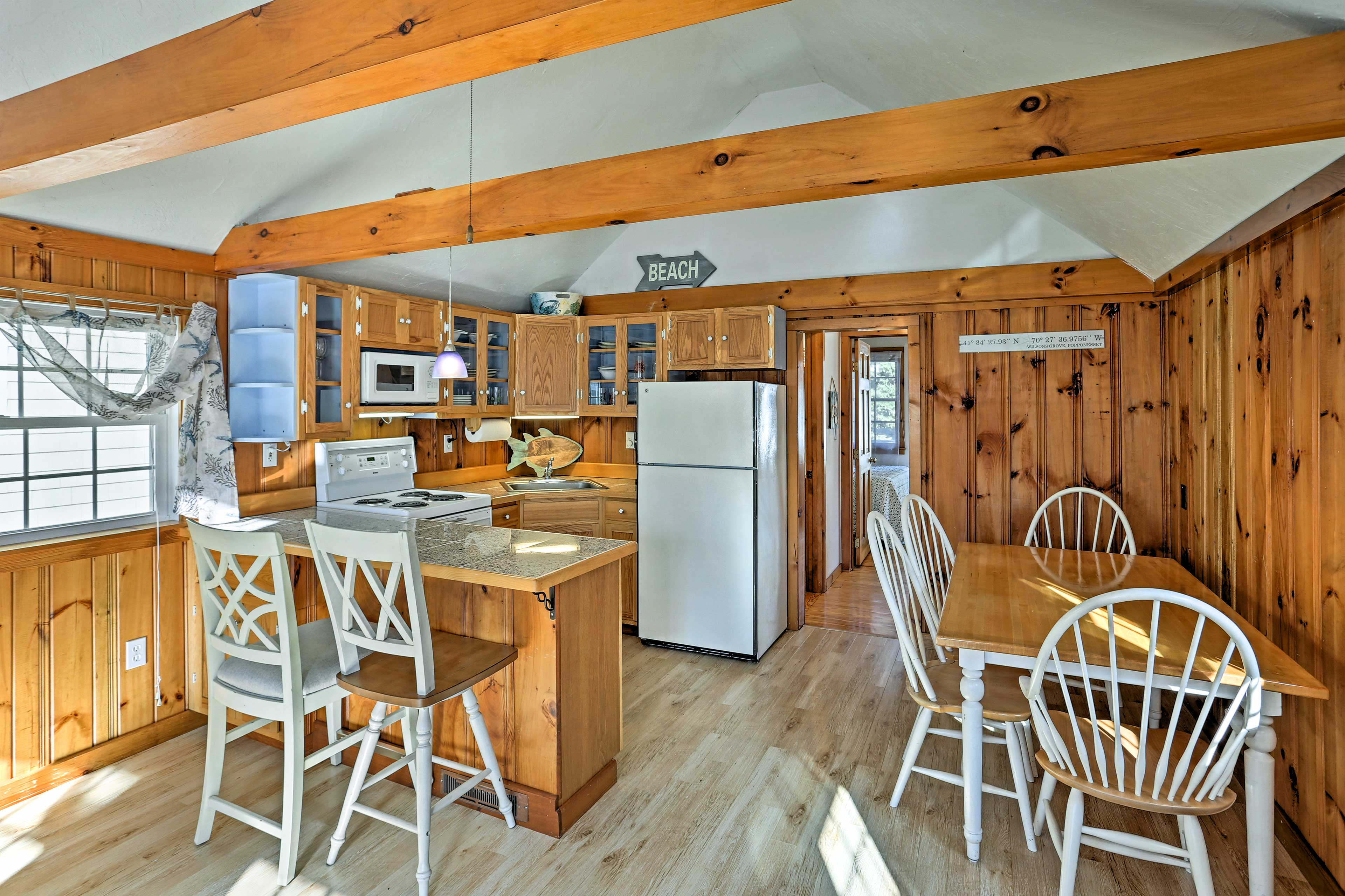 Dine in with the family at the 4-person table adjacent to the kitchen.