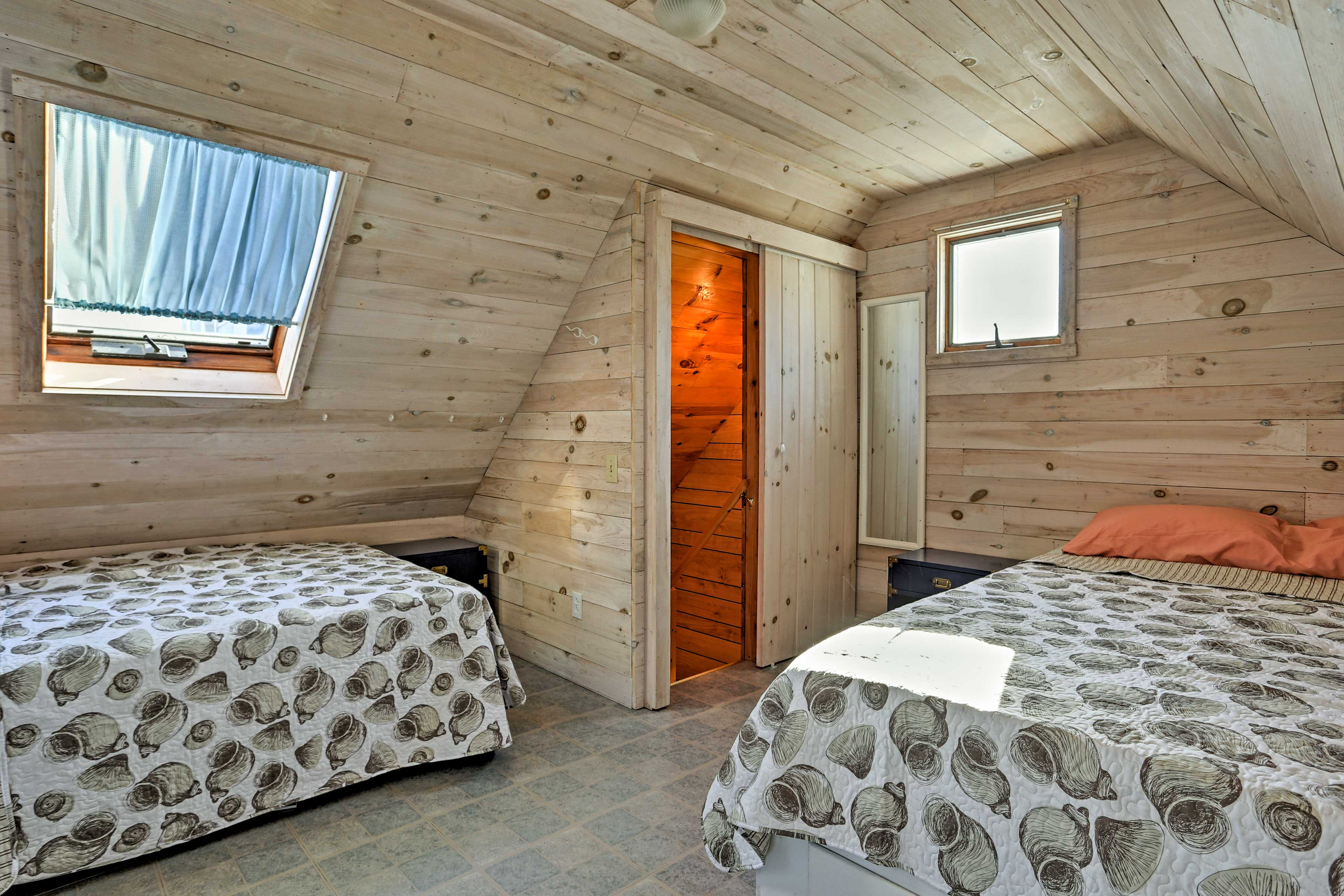 Venture upstairs to find the second bedroom, equipped with a full bed and twin.
