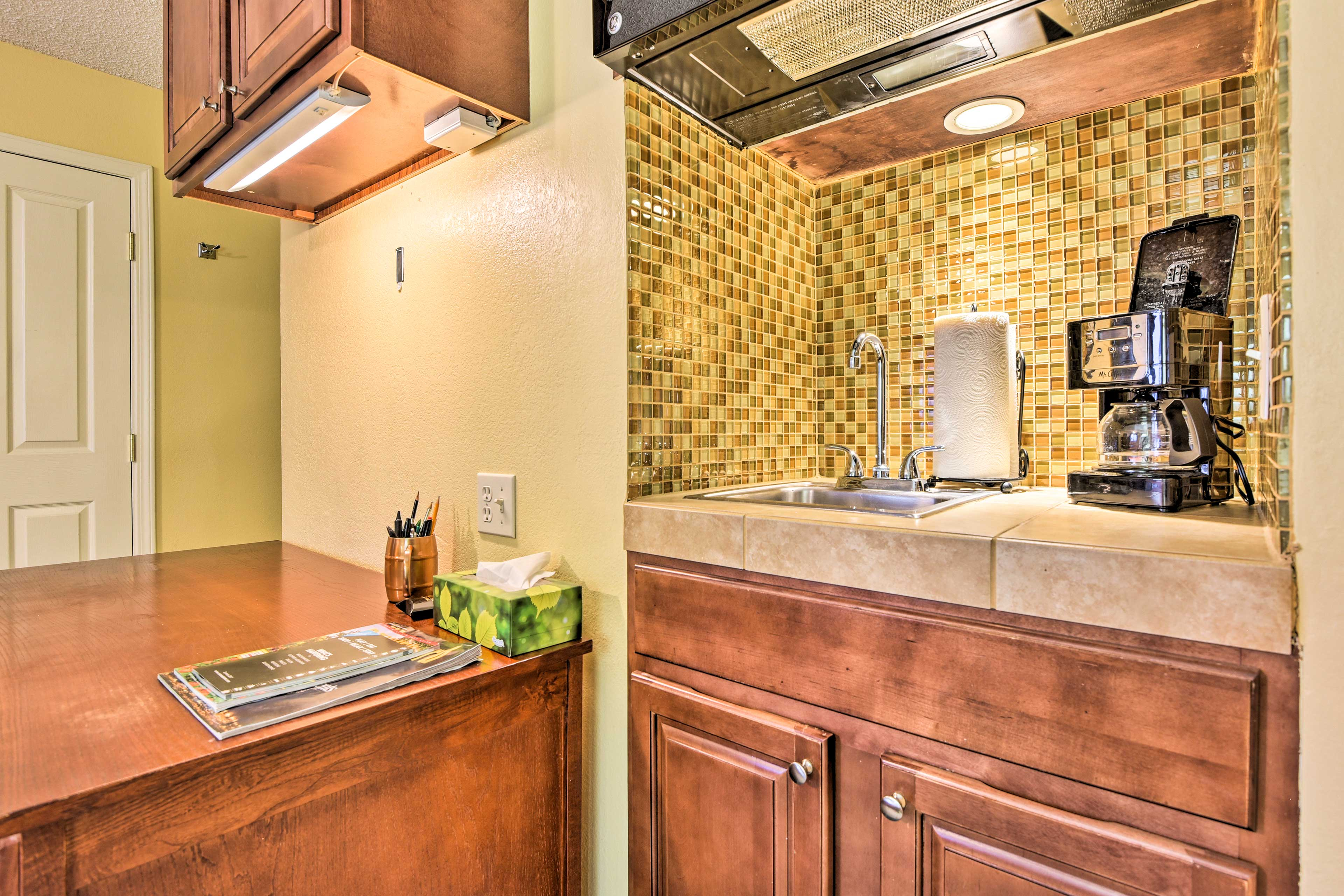 The kitchenette has a sink, coffeemaker and microwave.