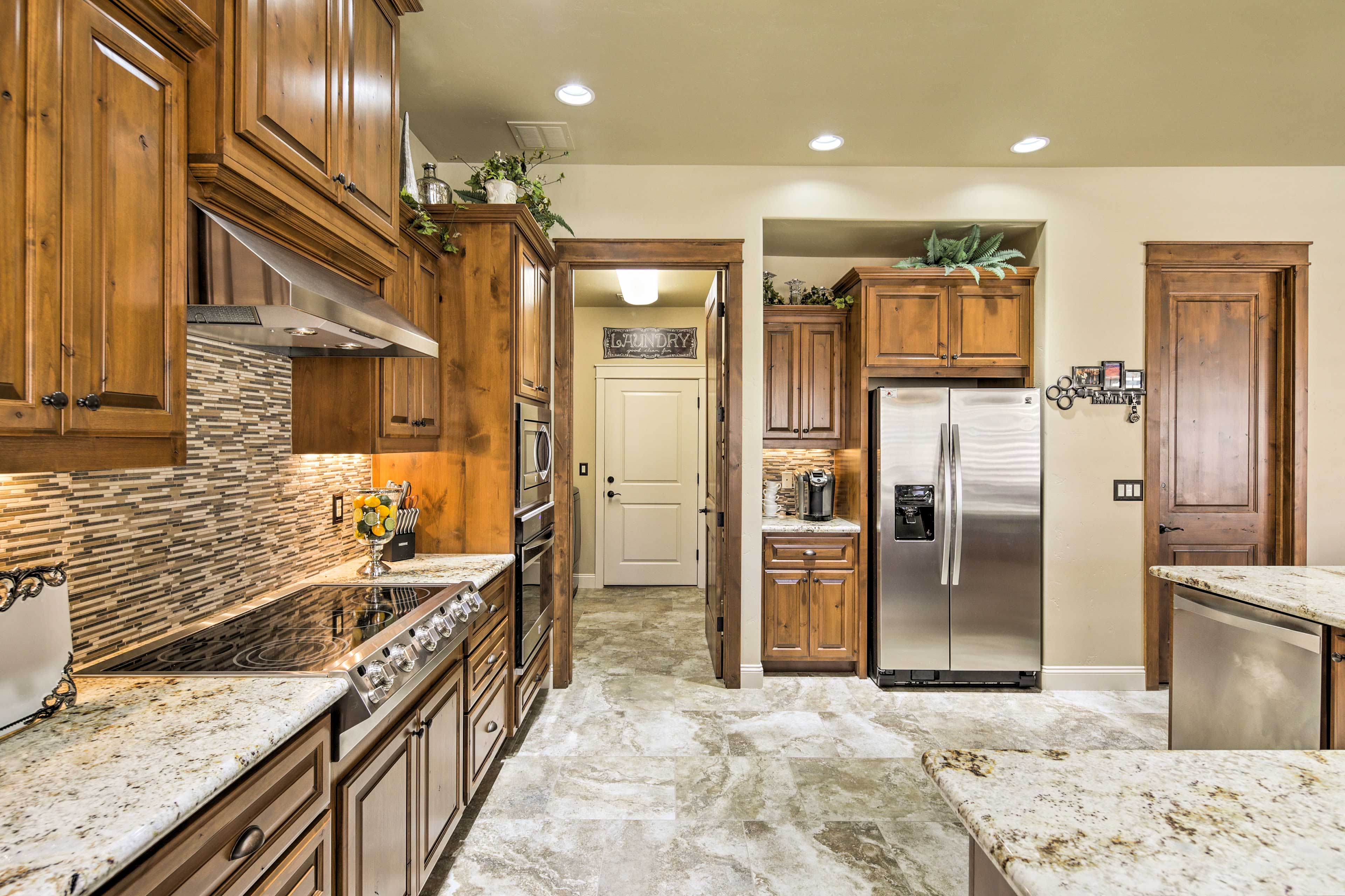 This kitchen comes fully equipped with stainless steel appliances.