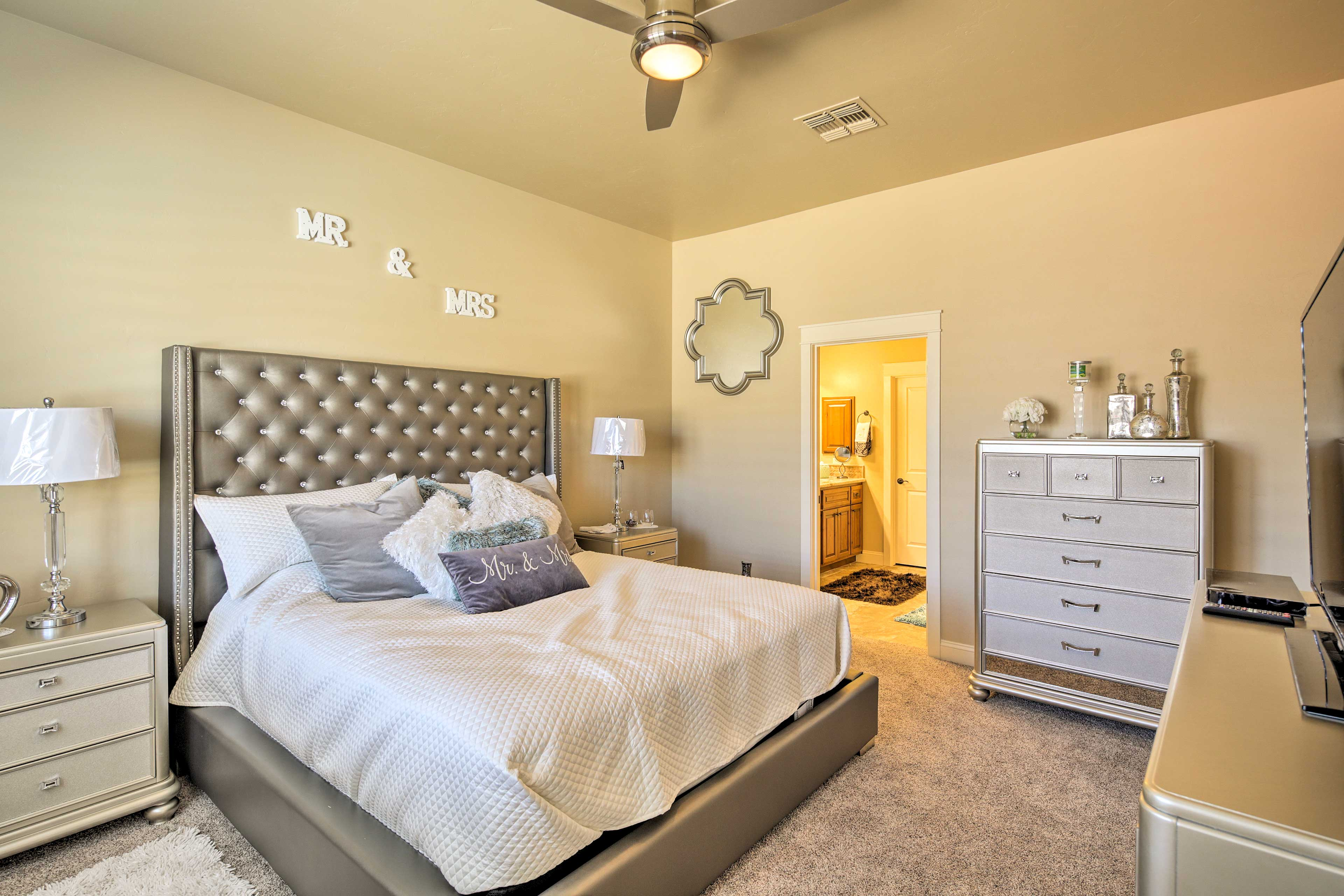 Come nighttime, this master bedroom offers a plush king bed.